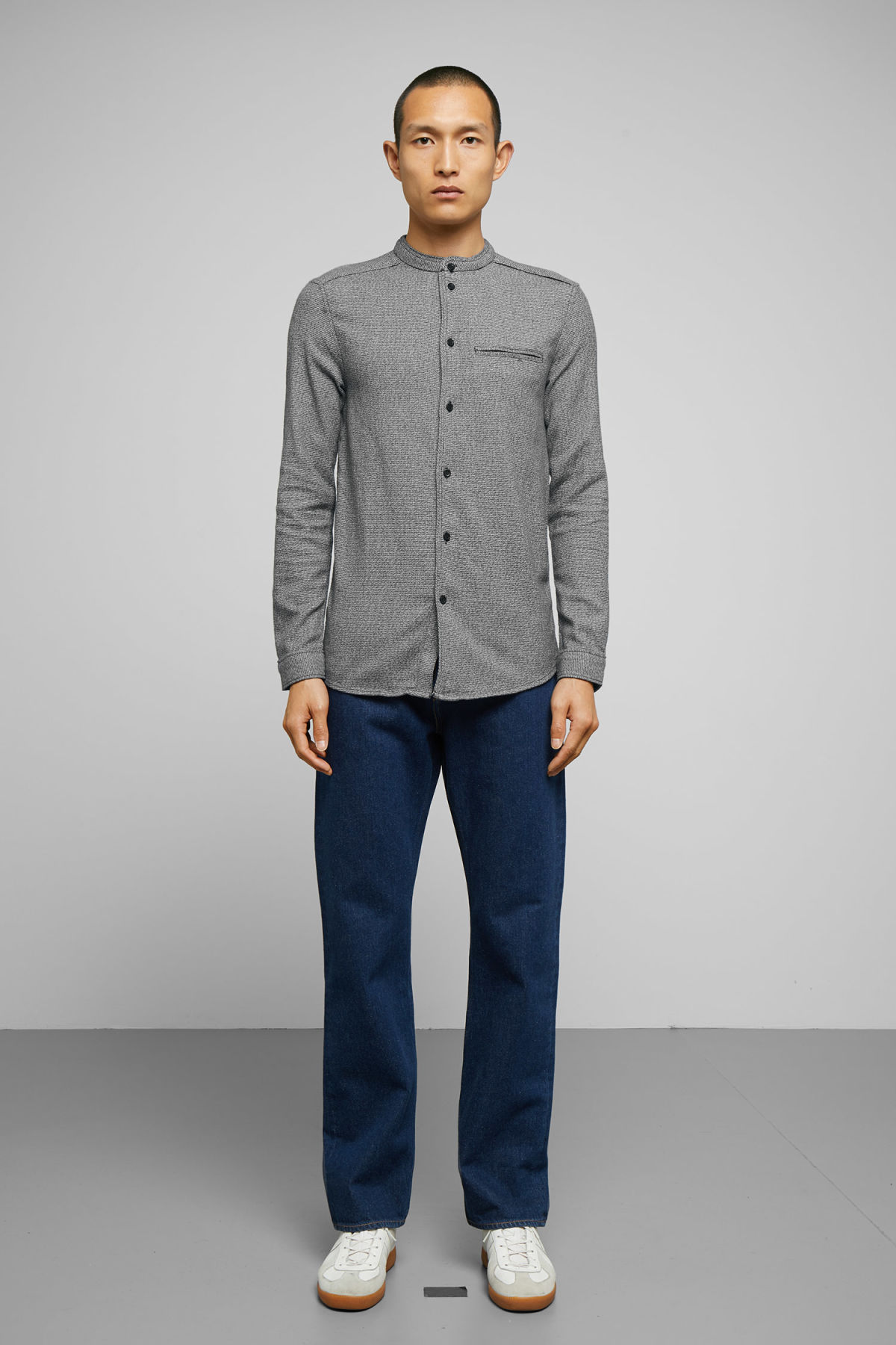 Model side image of Weekday hunt salt and pepper shirt in black