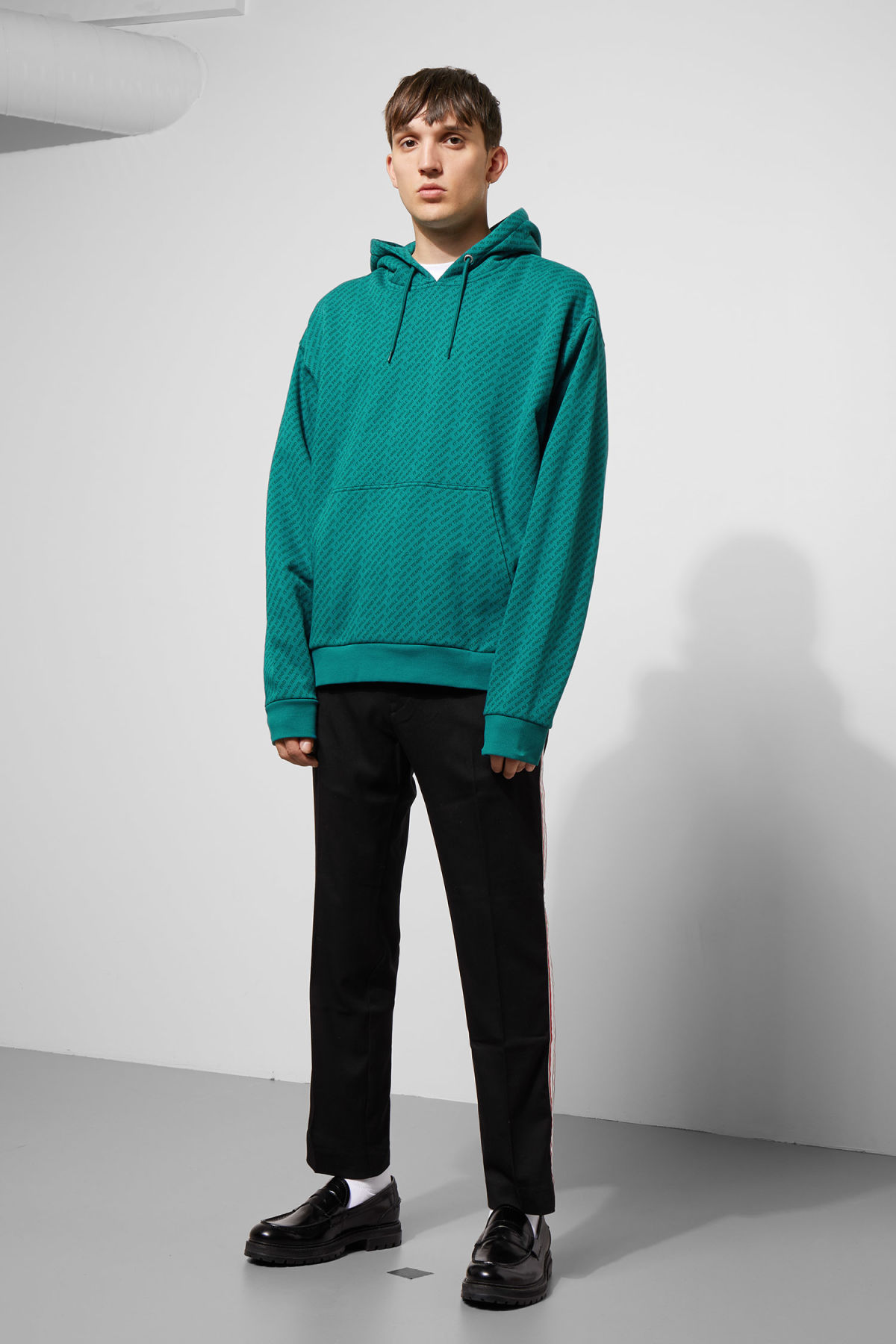 Model side image of Weekday big hawk tears hoodie in turquoise
