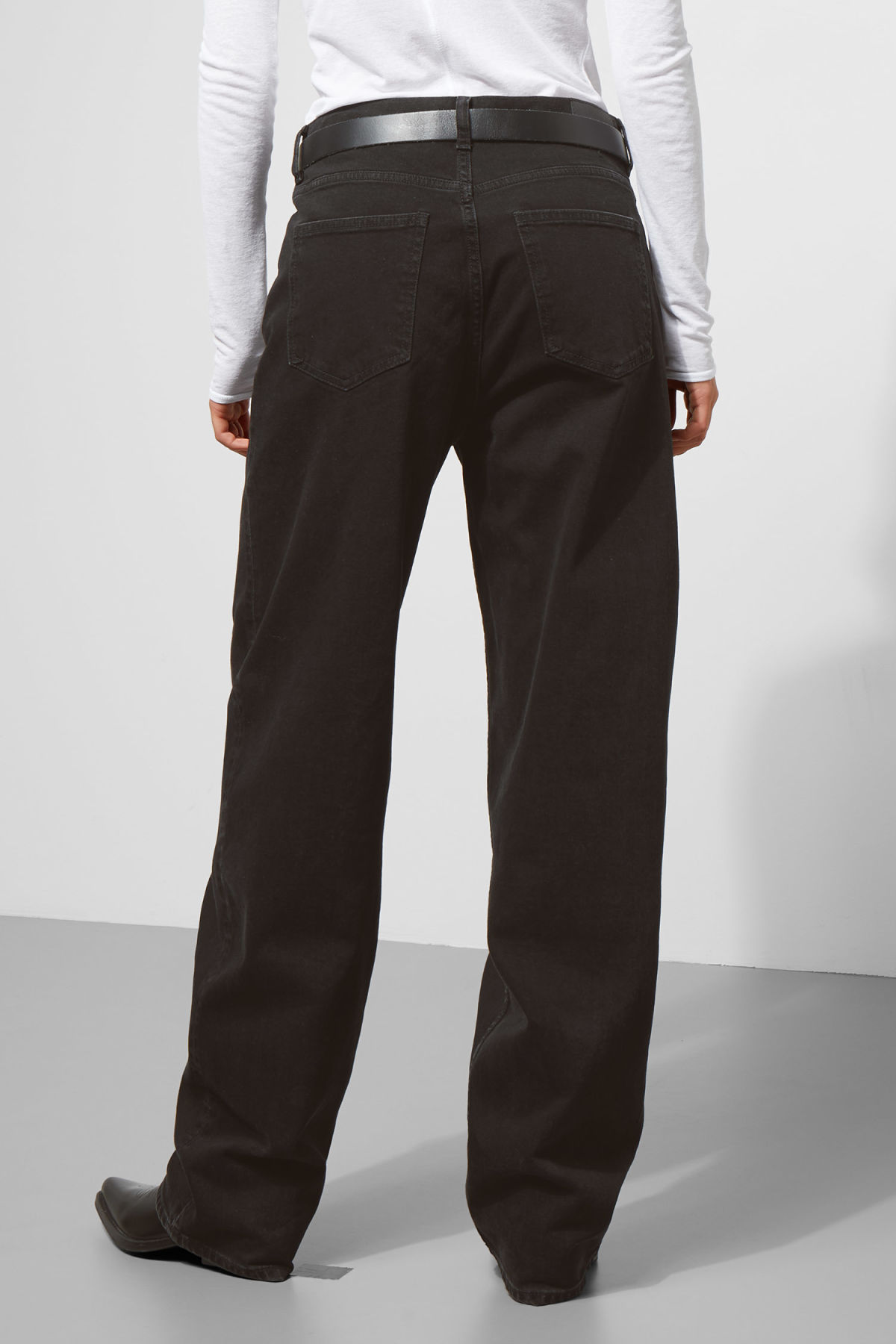 Model side image of Weekday rail black jeans in black