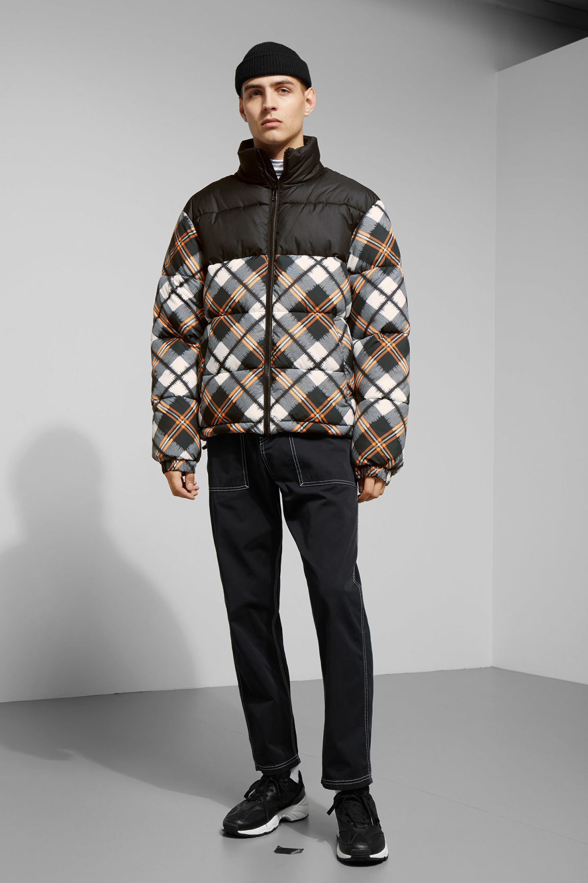 Model side image of Weekday cole checked jacket in black