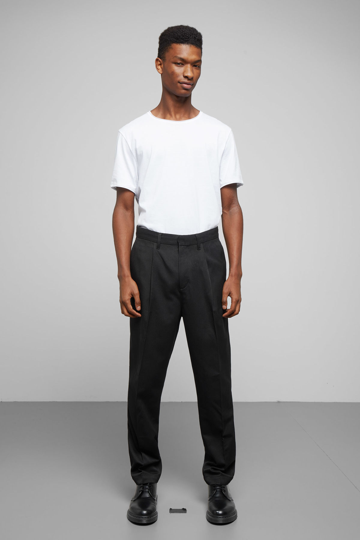 Model front image of Weekday paul pleated trousers in black