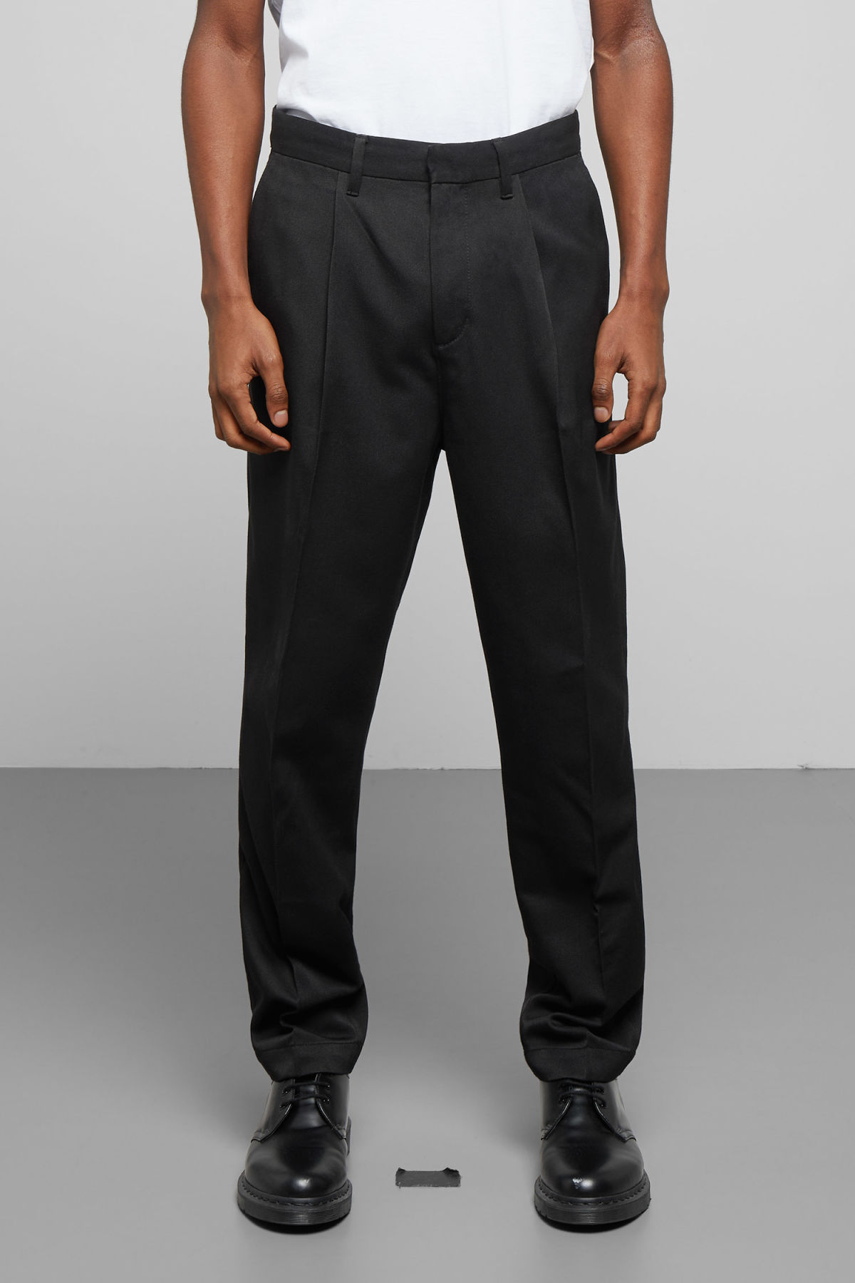 Model side image of Weekday paul pleated trousers in black