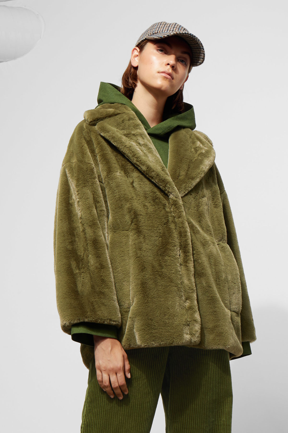 Model front image of Weekday tabitha faux fur jacket in green