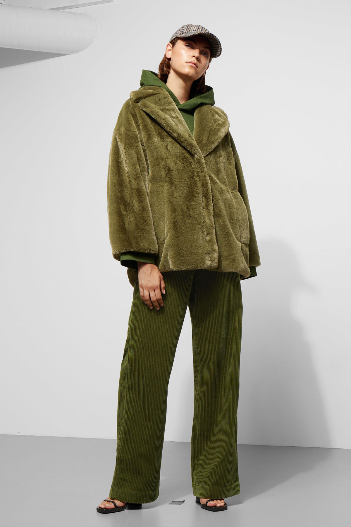 Model side image of Weekday tabitha faux fur jacket in green