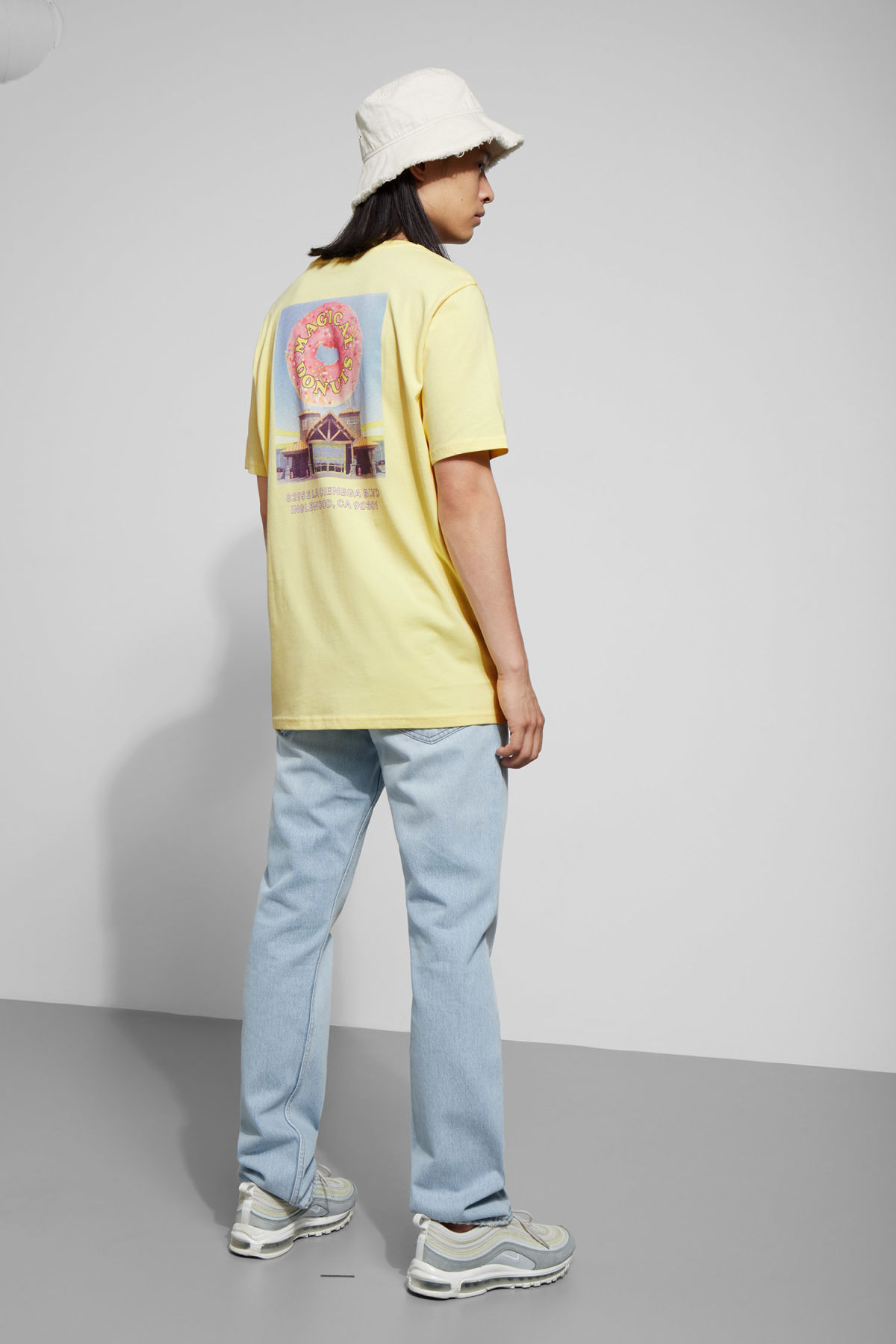 Model back image of Weekday frank donuts t-shirt in yellow