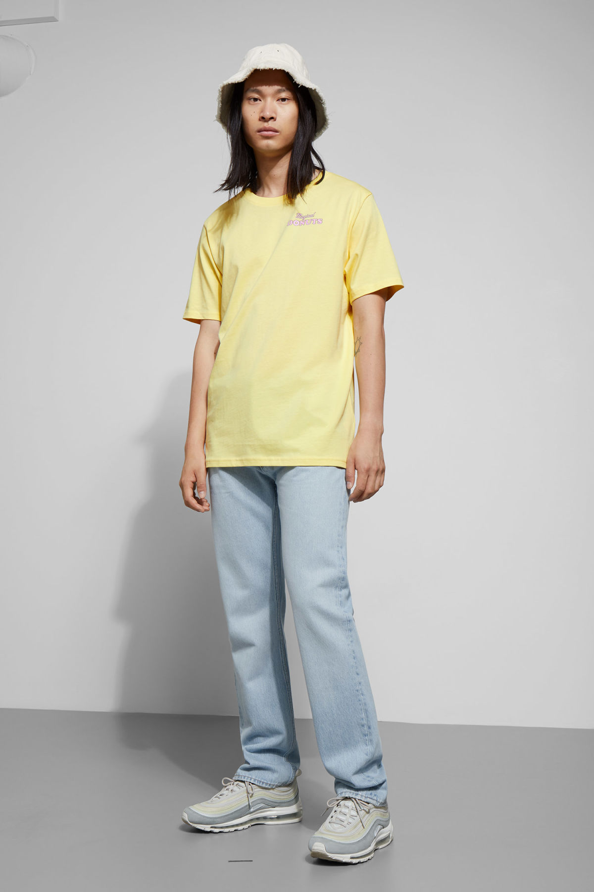 Model side image of Weekday frank donuts t-shirt in yellow
