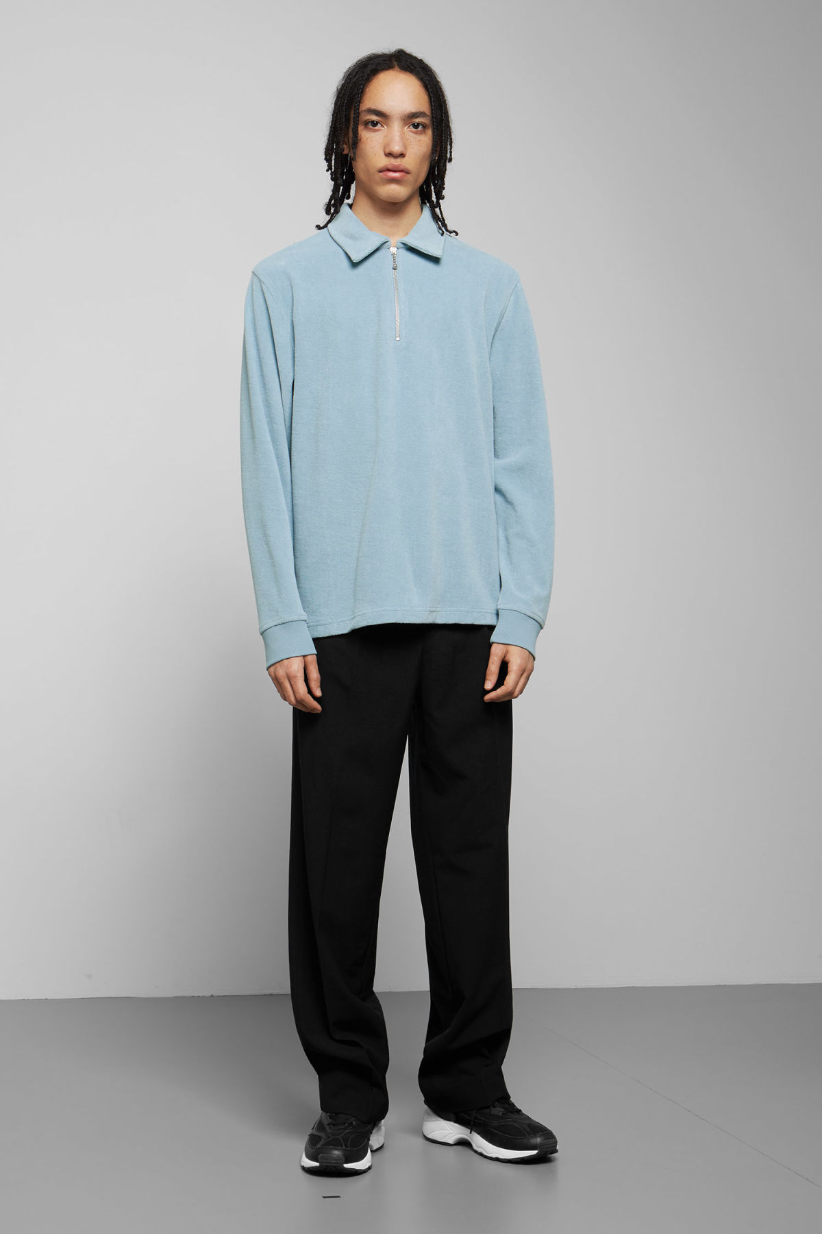 Model side image of Weekday timo half zip sweatshirt in blue