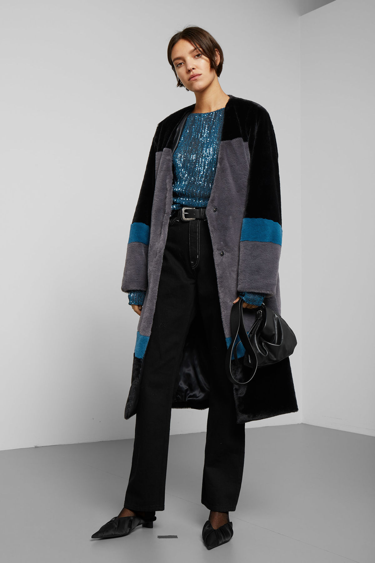 Model front image of Weekday domra coat in black