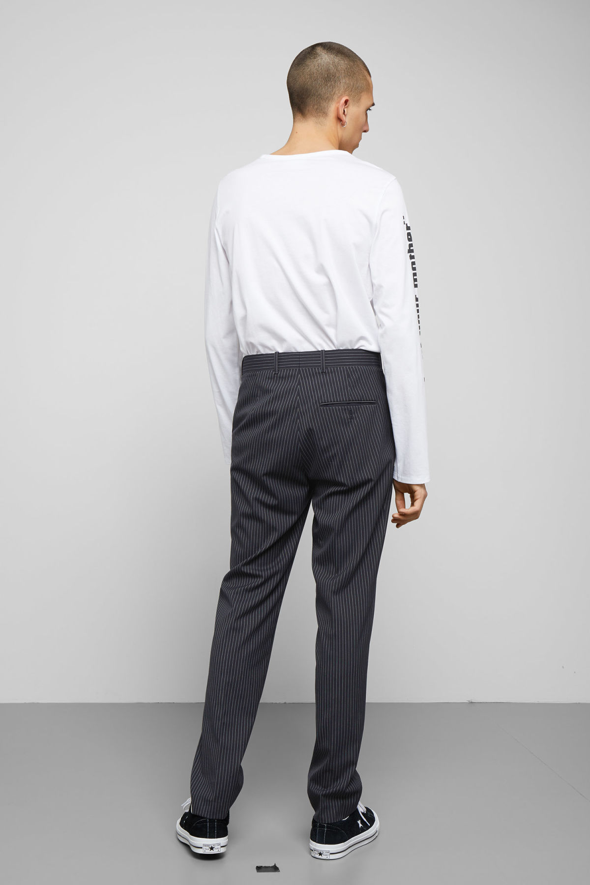 Model back image of Weekday bodie pinstriped trousers in blue