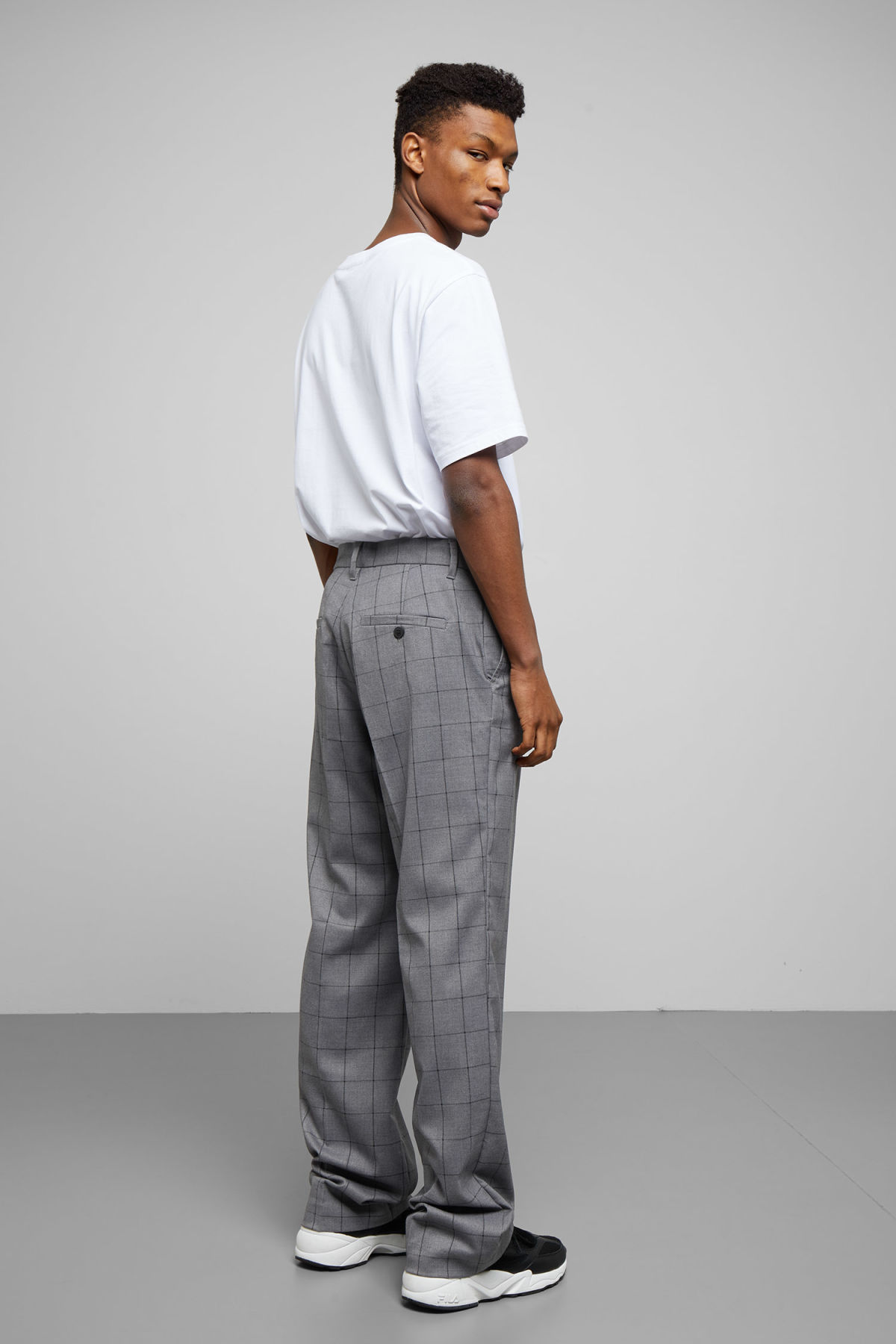 Model side image of Weekday sala trousers in grey