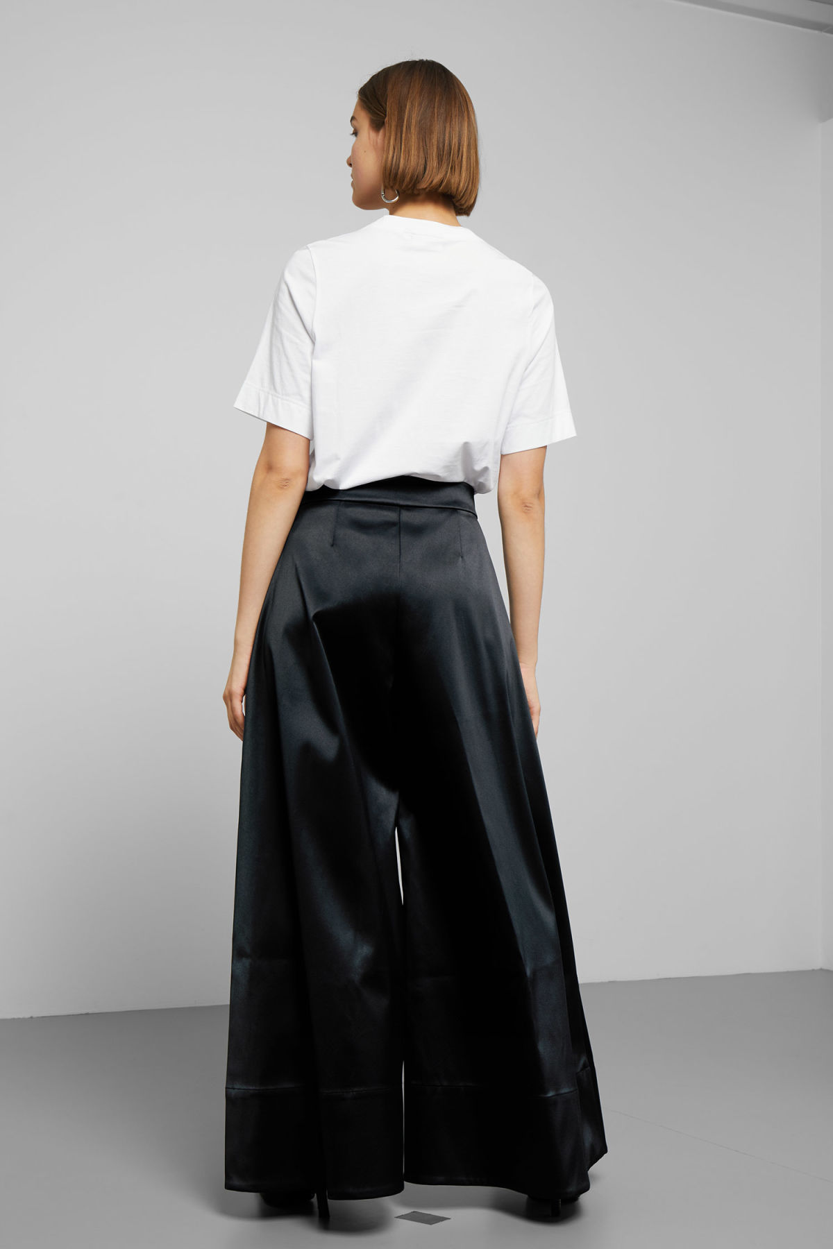 Model side image of Weekday madison wide satin trousers in black