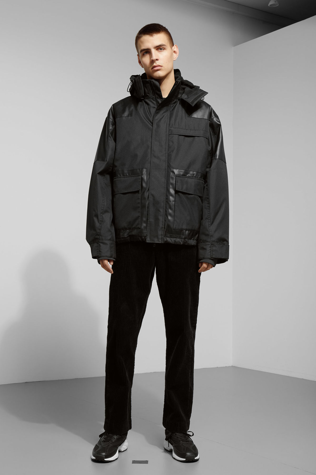 Model side image of Weekday brumal jacket in black