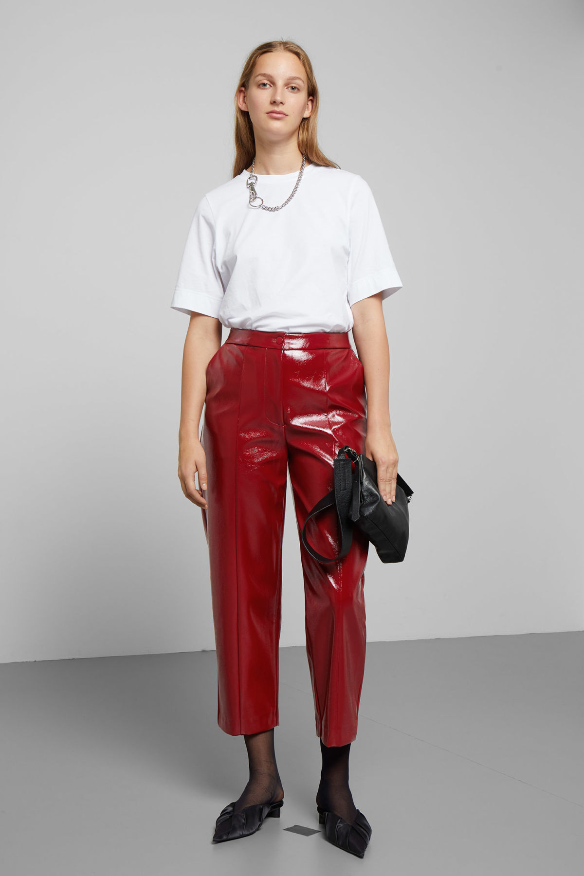 Model front image of Weekday kylie patent trousers in red