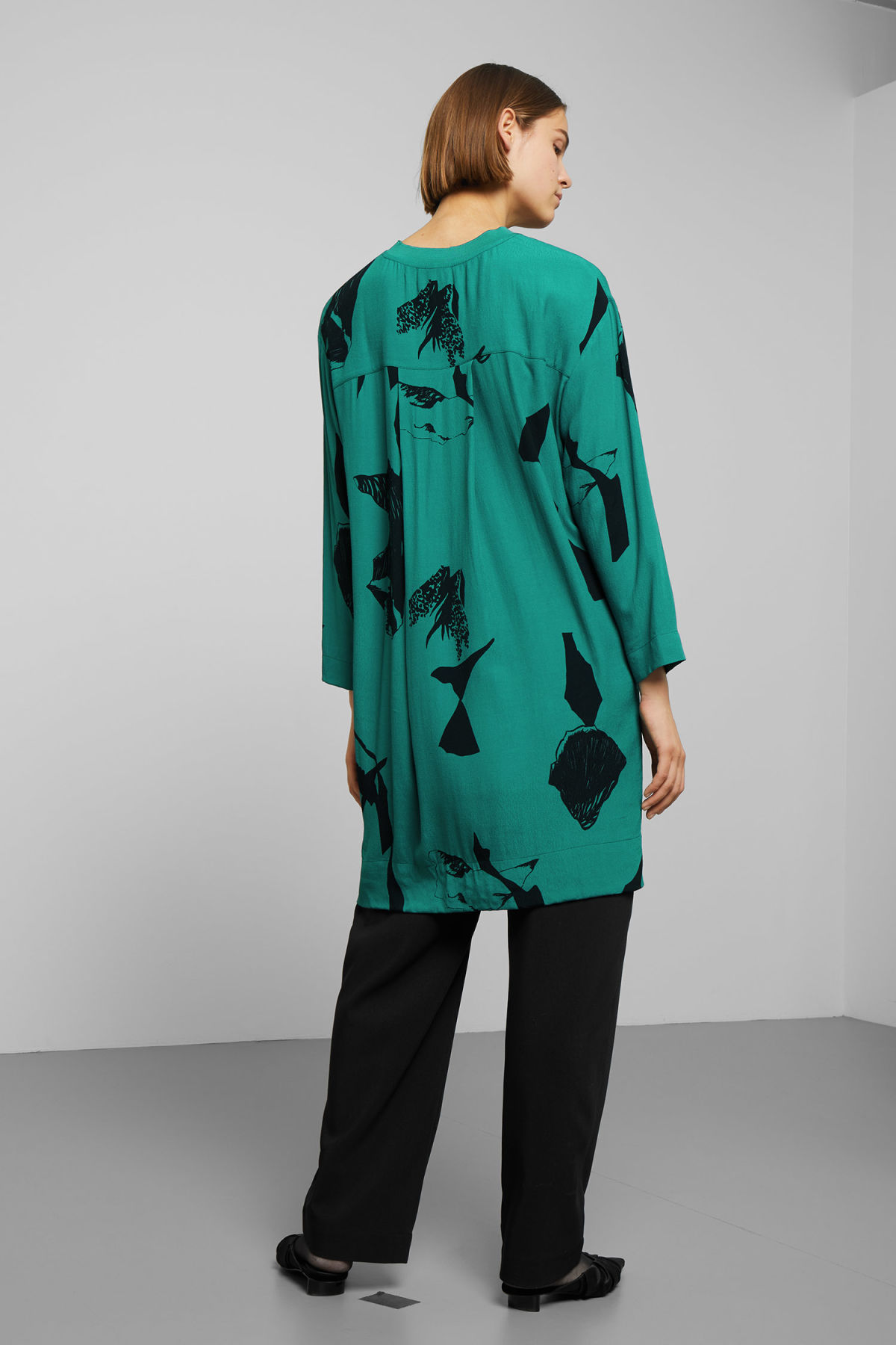 Model side image of Weekday dania woven dress in turquoise