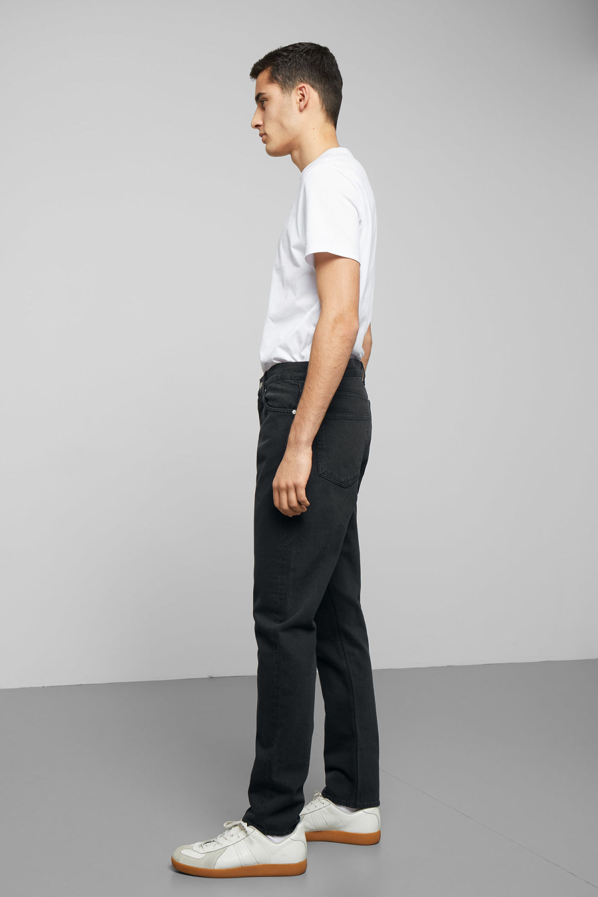 Model side image of Weekday pine mine black jeans in black