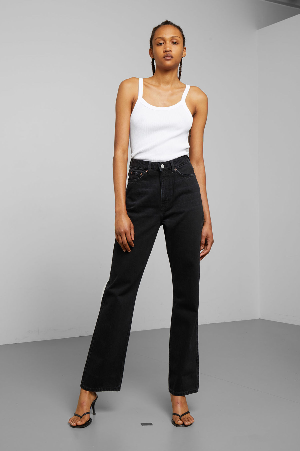 Model front image of Weekday row echo black jeans in black