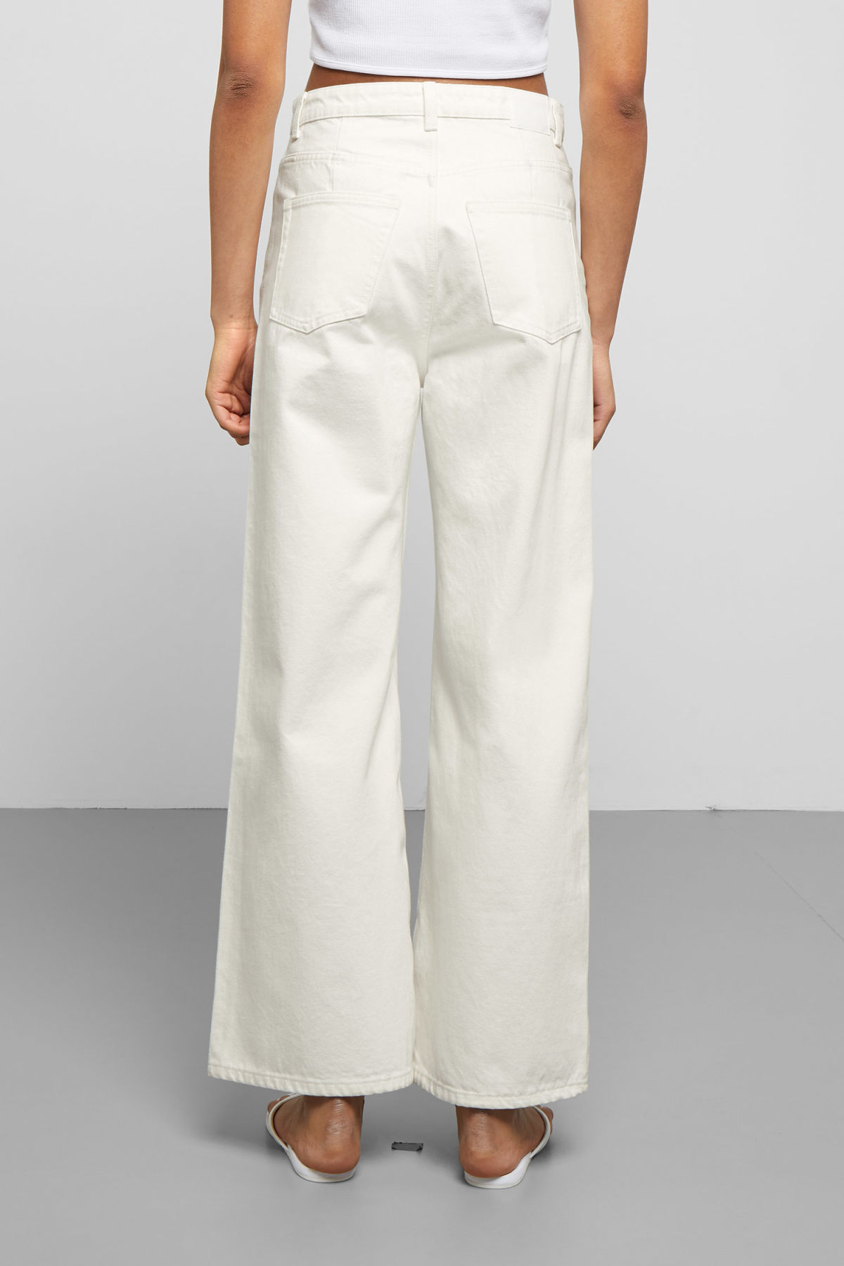 Model side image of Weekday ace white jeans in white