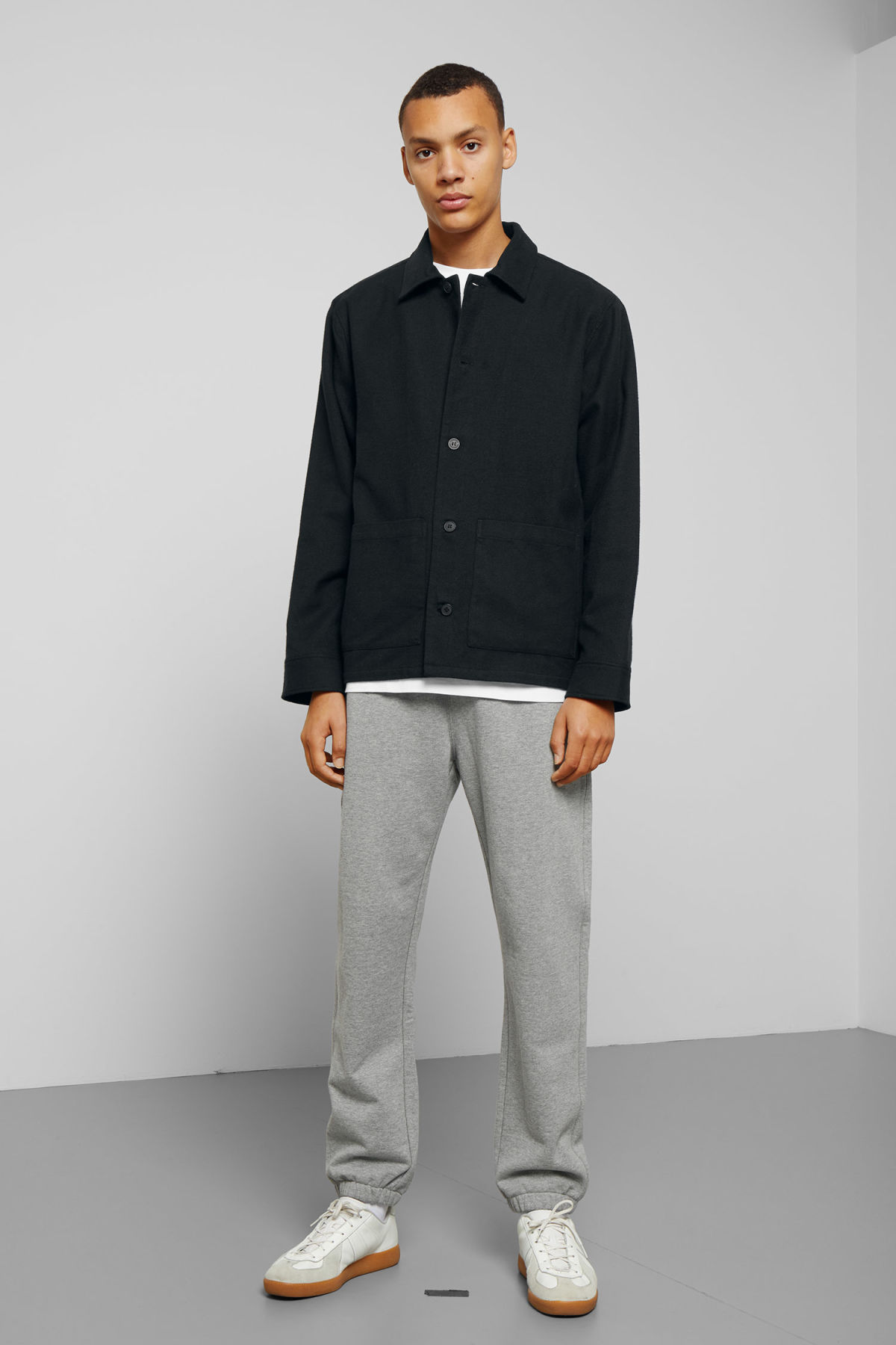 Model side image of Weekday genny overshirt in black