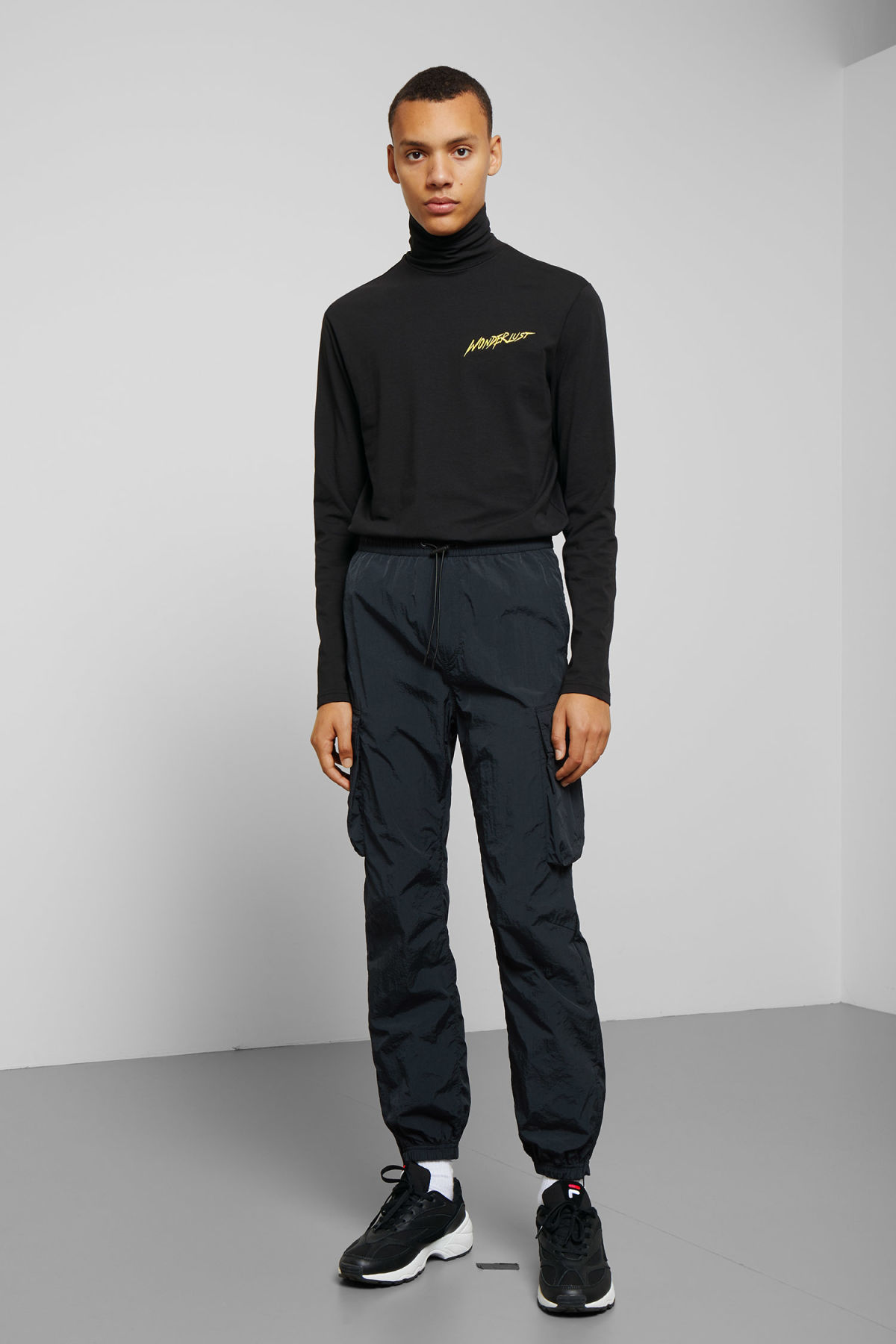Model side image of Weekday ted wonderlust turtleneck in black