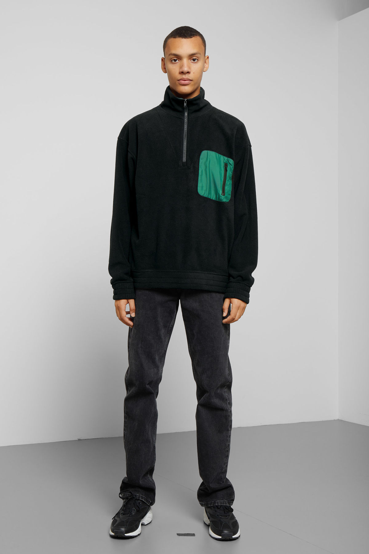 Model side image of Weekday micro halfzip sweatshirt in black