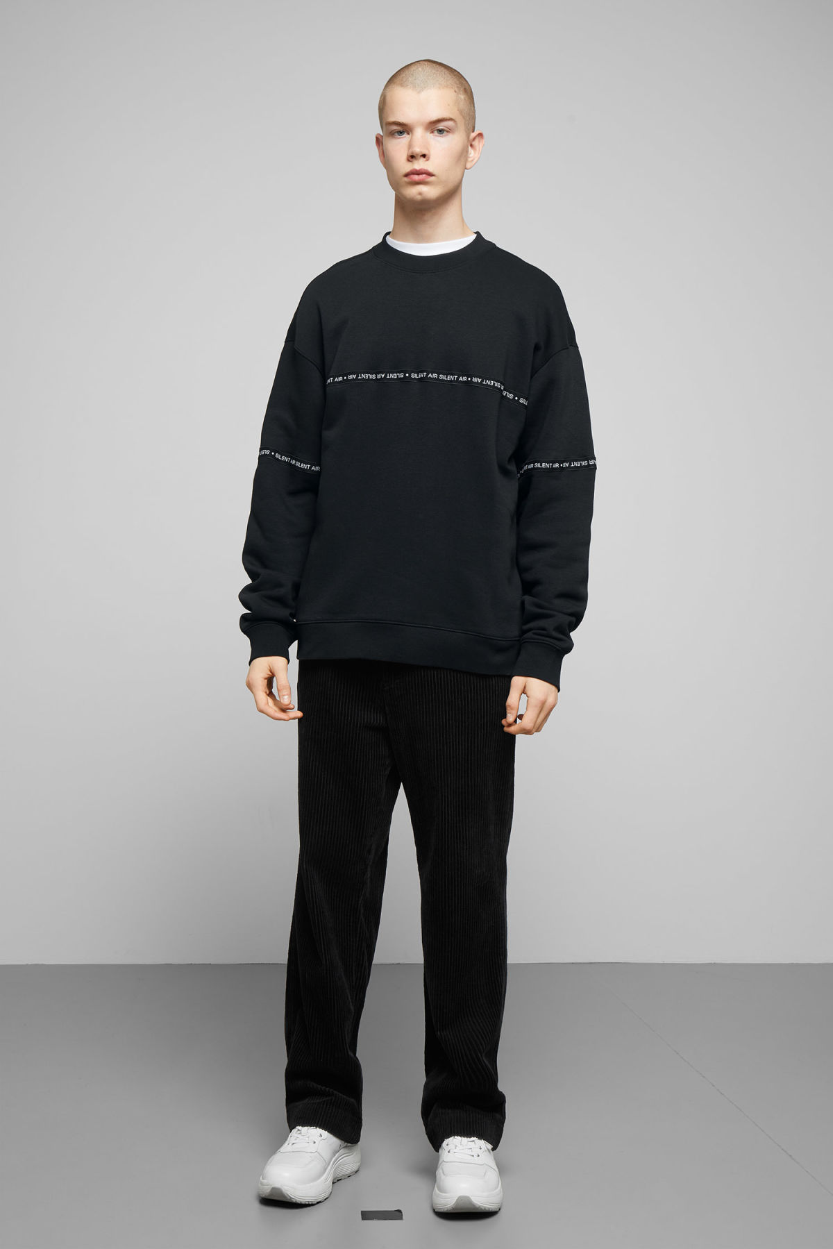 Model side image of Weekday big steve ribbon sweatshirt  in black