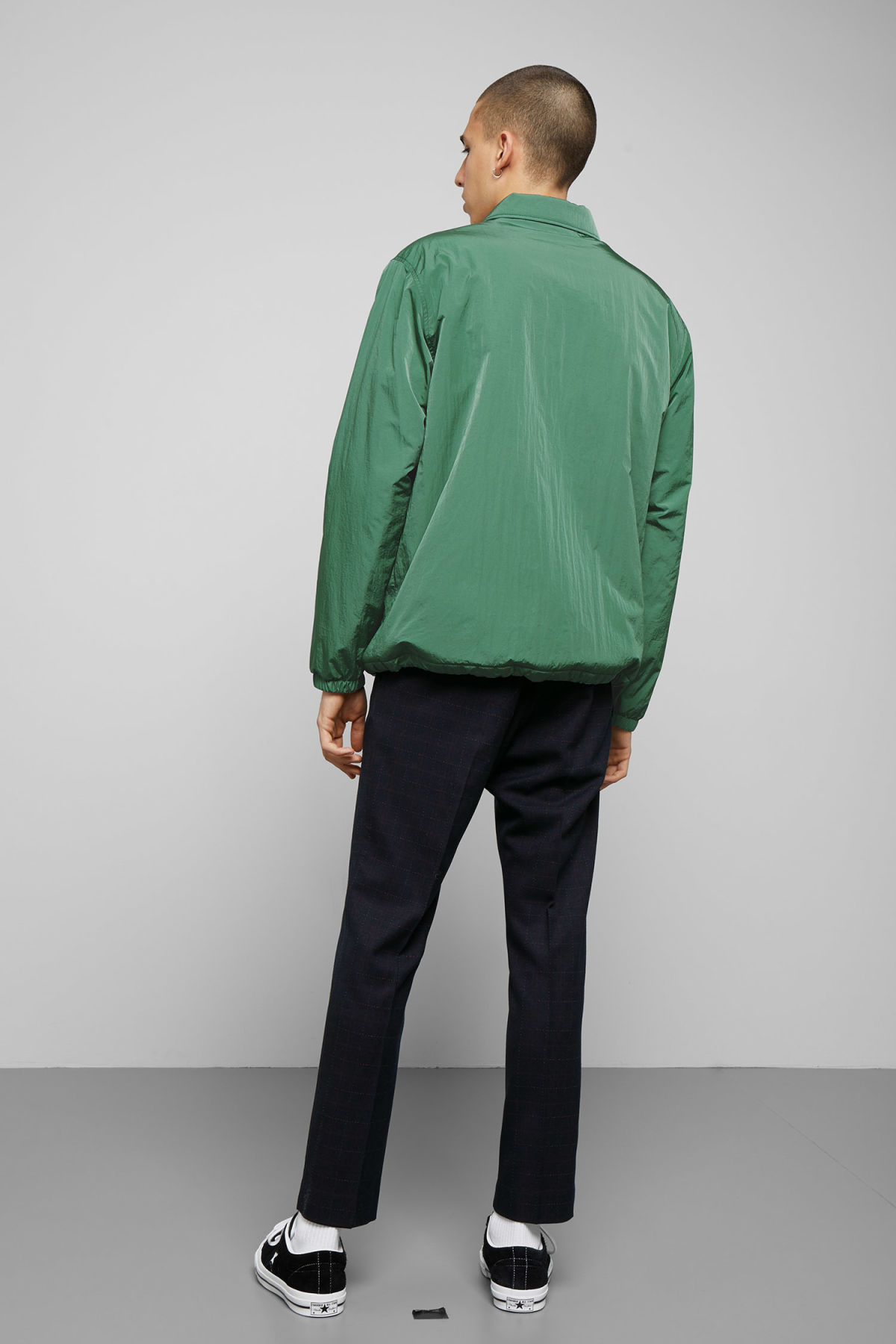 Model side image of Weekday bob coach jacket in green