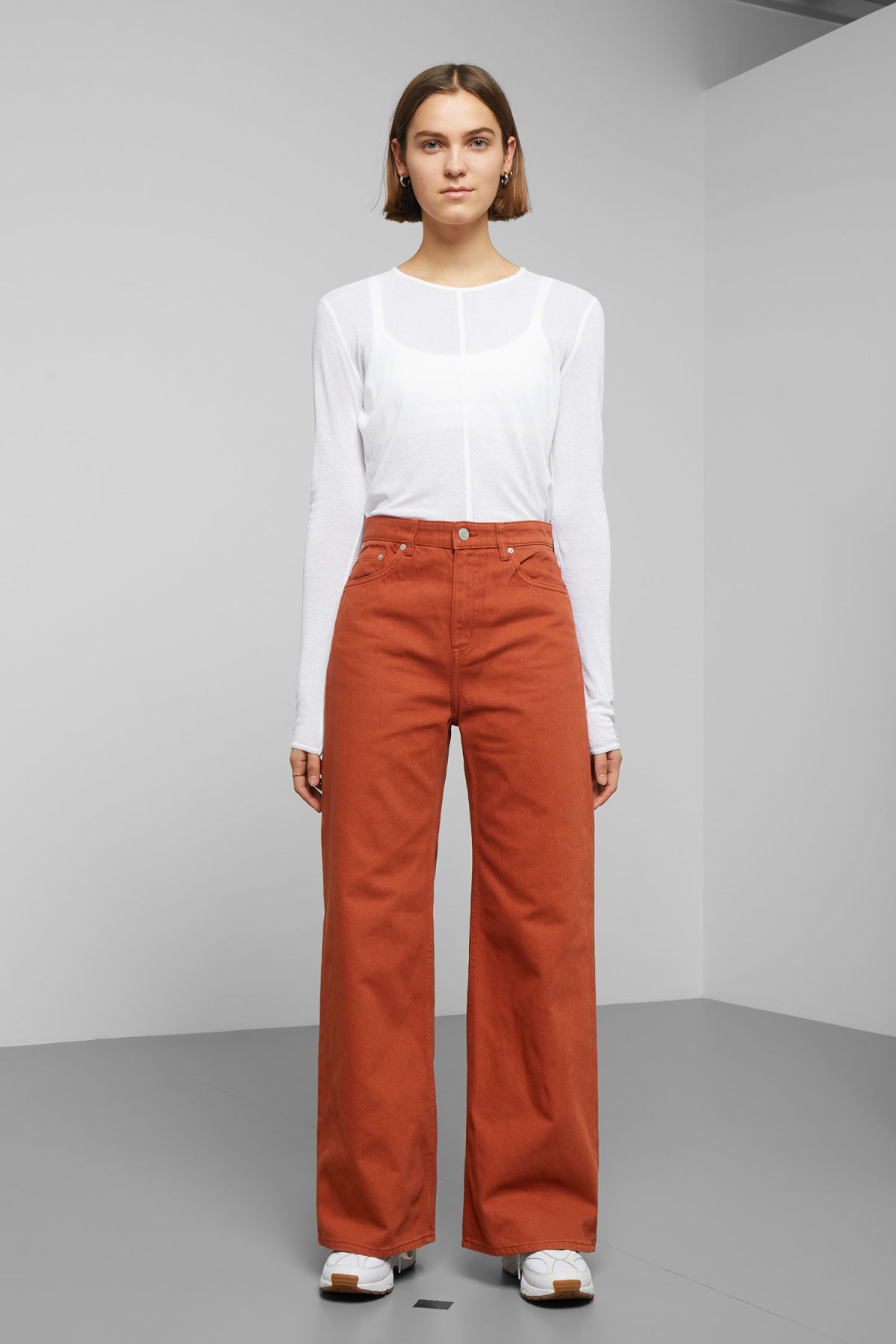 Model front image of Weekday ace rust jeans in orange