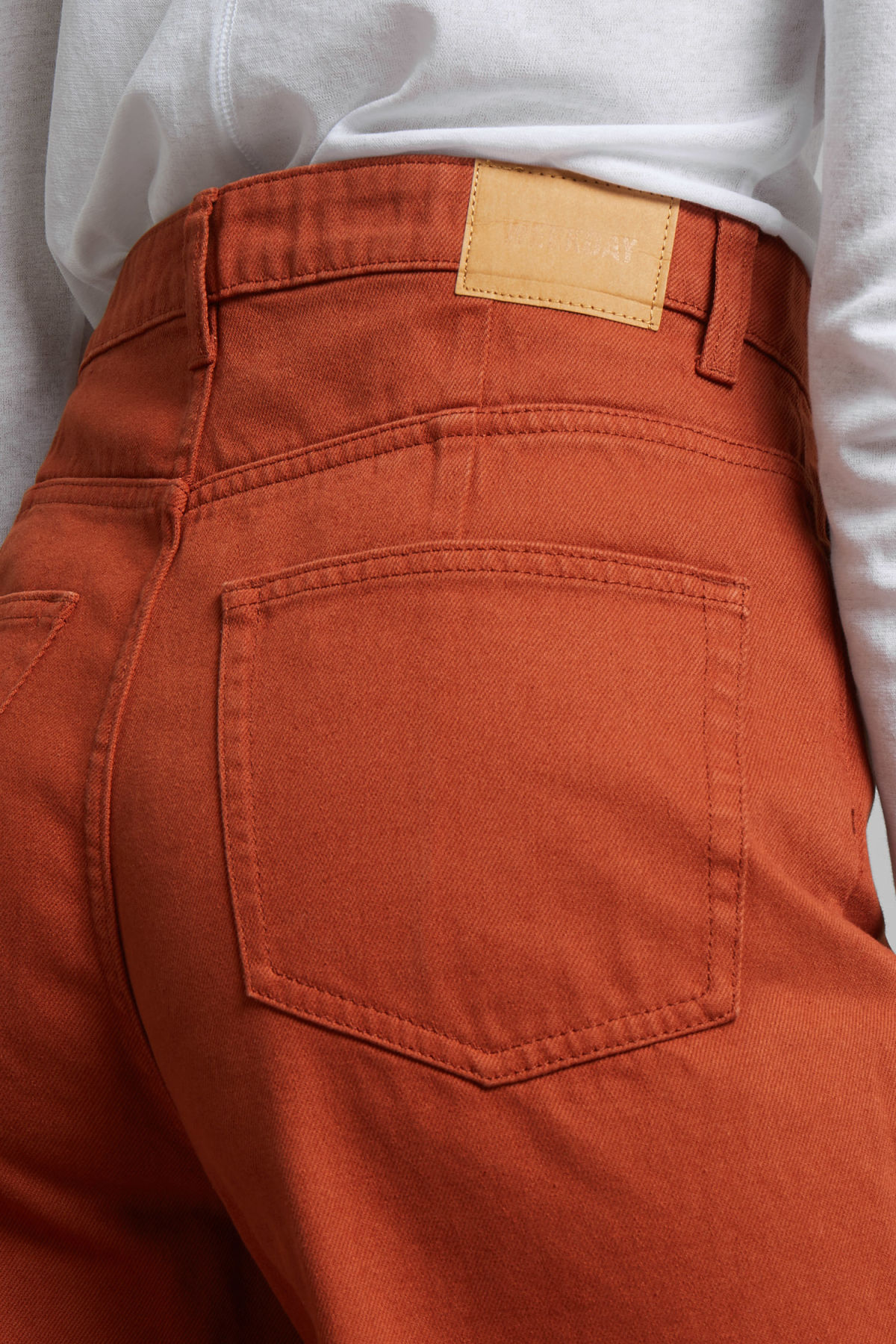 Model side image of Weekday ace rust jeans in orange