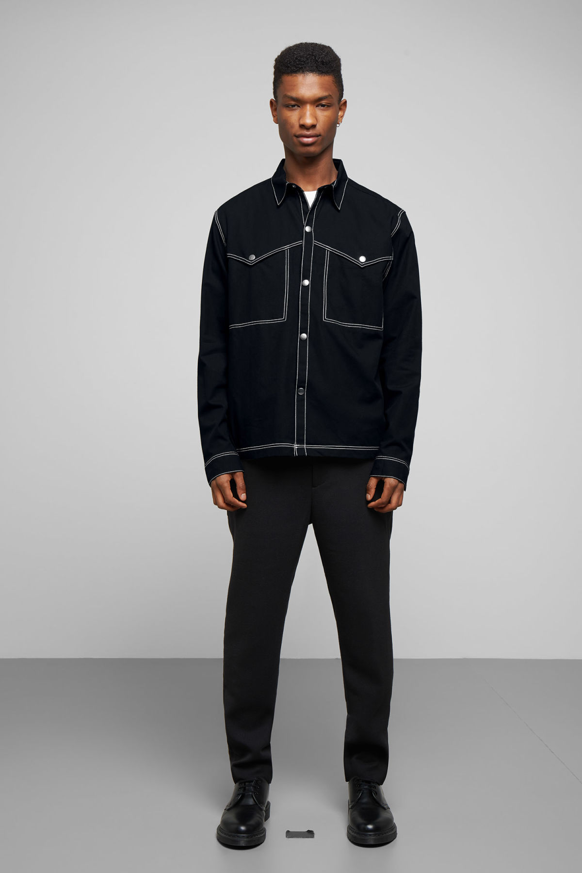 Model side image of Weekday spin shirt in black