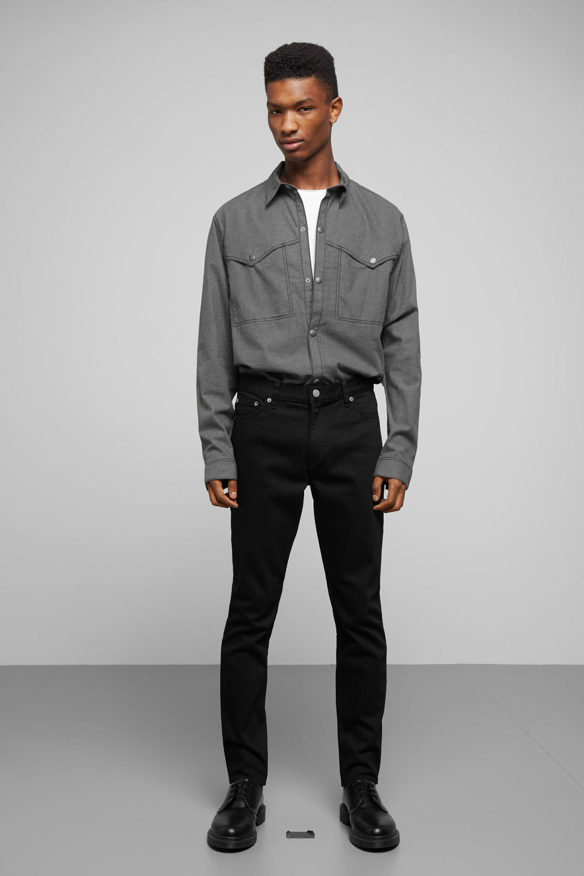 Model side image of Weekday spin shirt in grey
