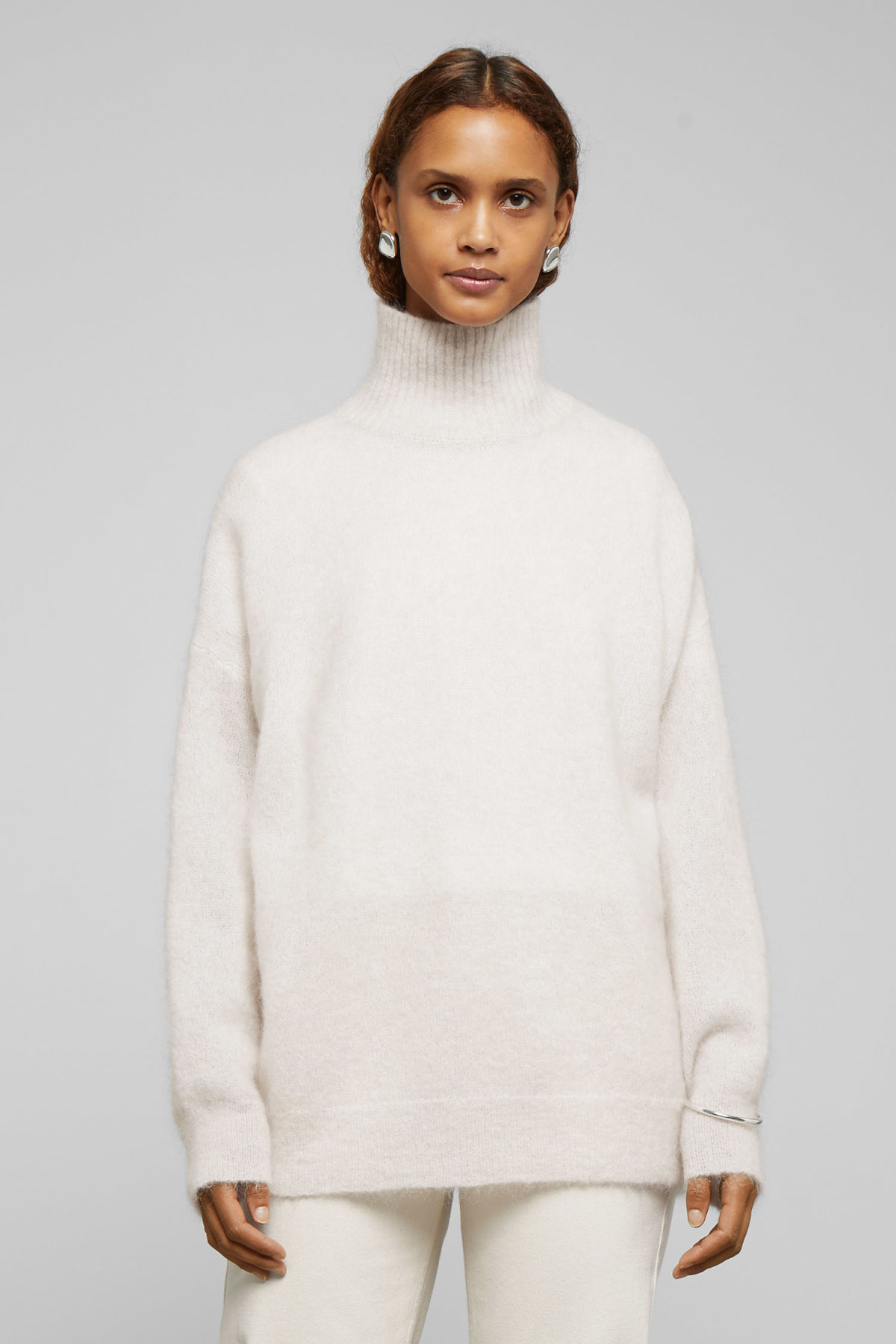 Model front image of Weekday hailey wool and mohair blend turtleneck in beige