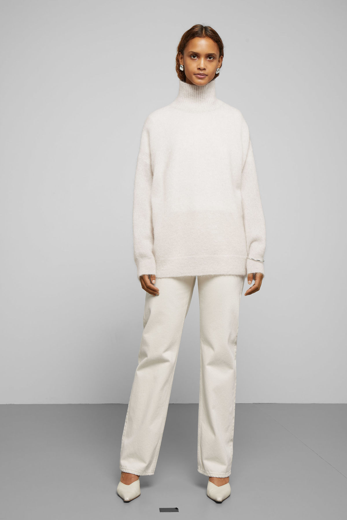 Model side image of Weekday hailey wool and mohair blend turtleneck in beige