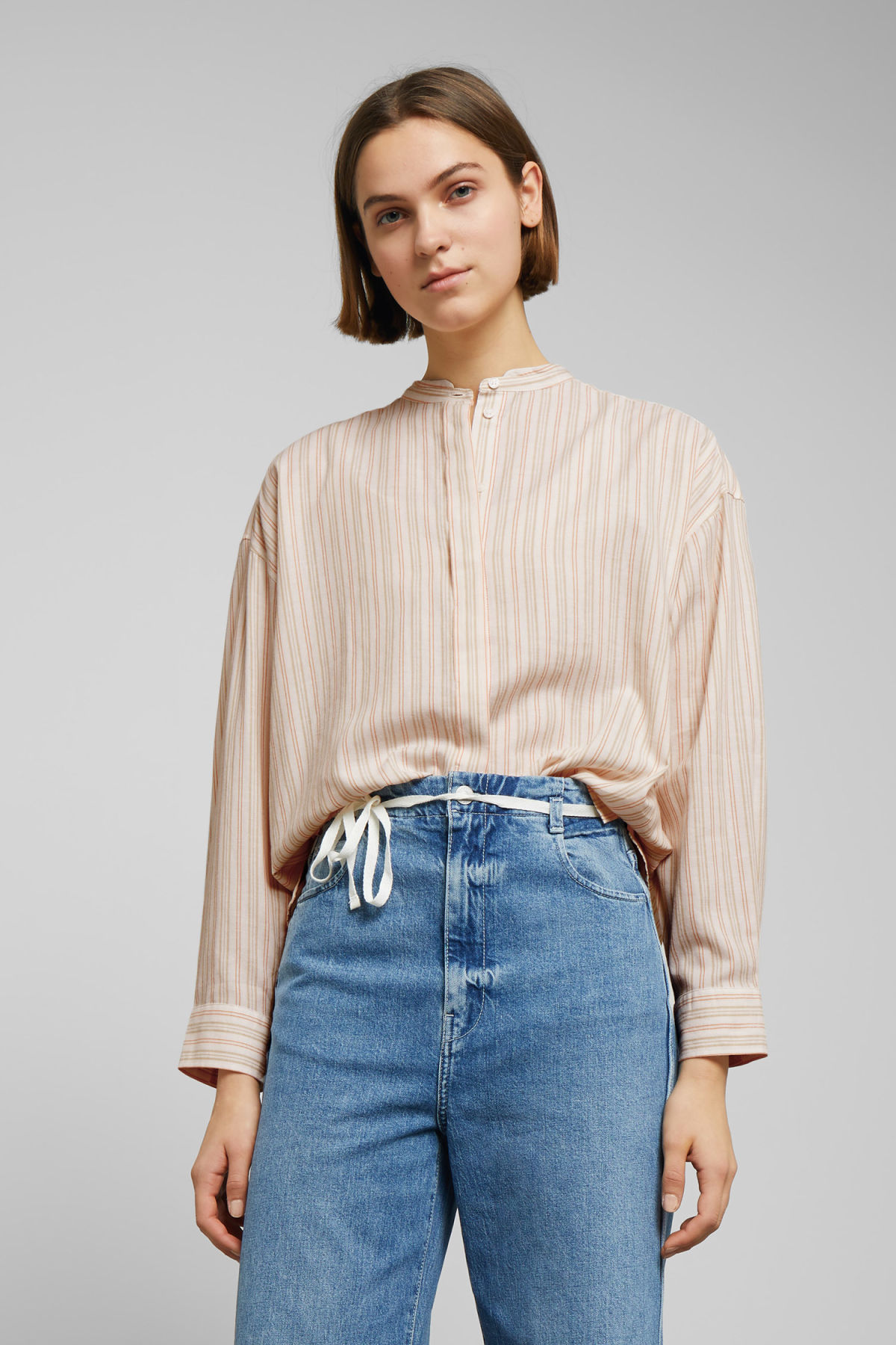 Model front image of Weekday lora shirt in beige