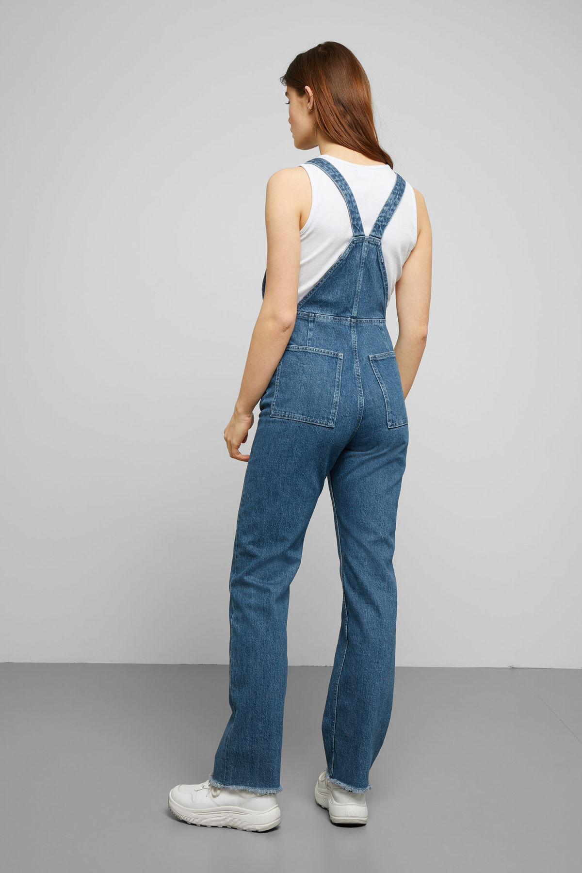 Model side image of Weekday lo denim dungarees in blue
