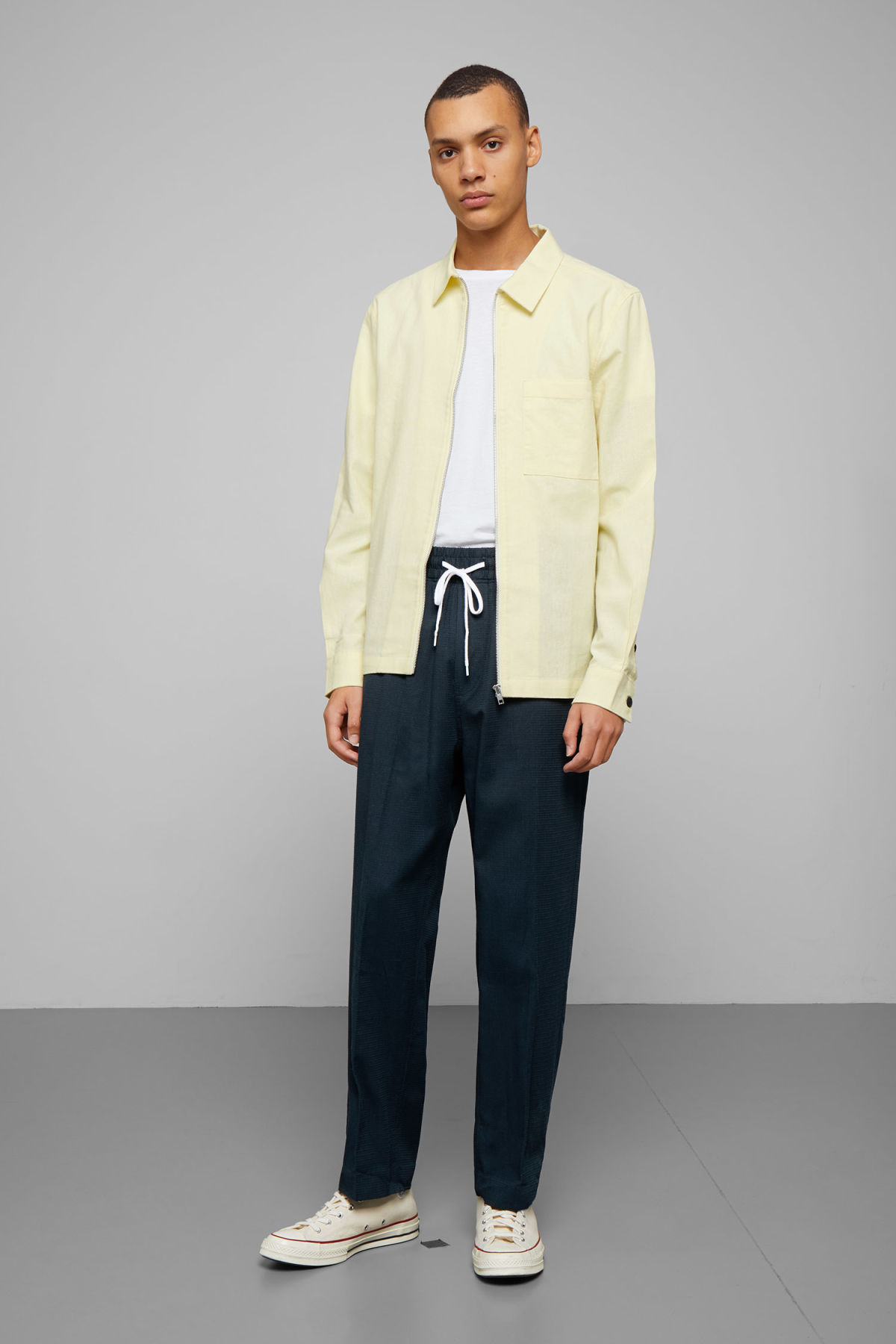 Model side image of Weekday temp linen zip shirt in yellow