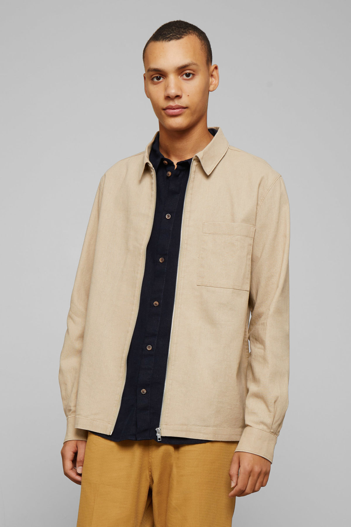 Model front image of Weekday temp linen zip shirt in beige