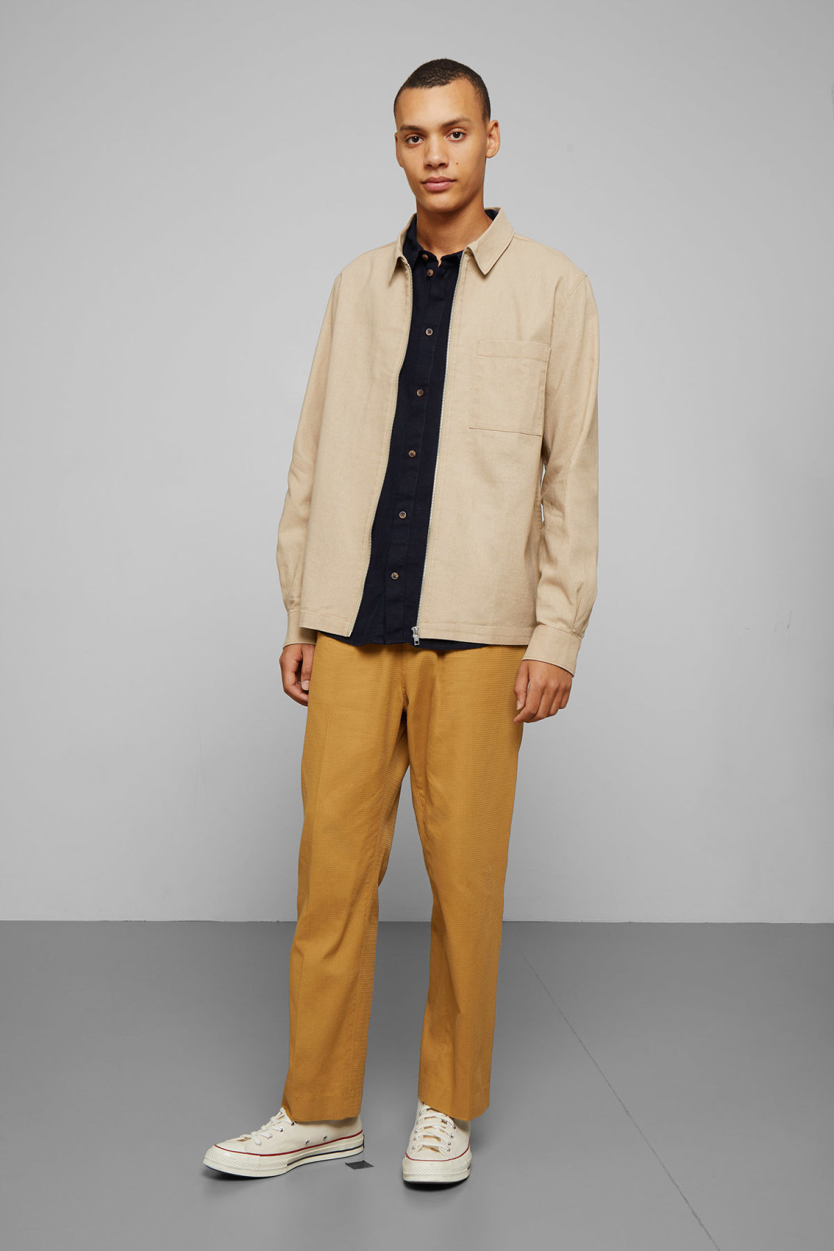 Model side image of Weekday temp linen zip shirt in beige