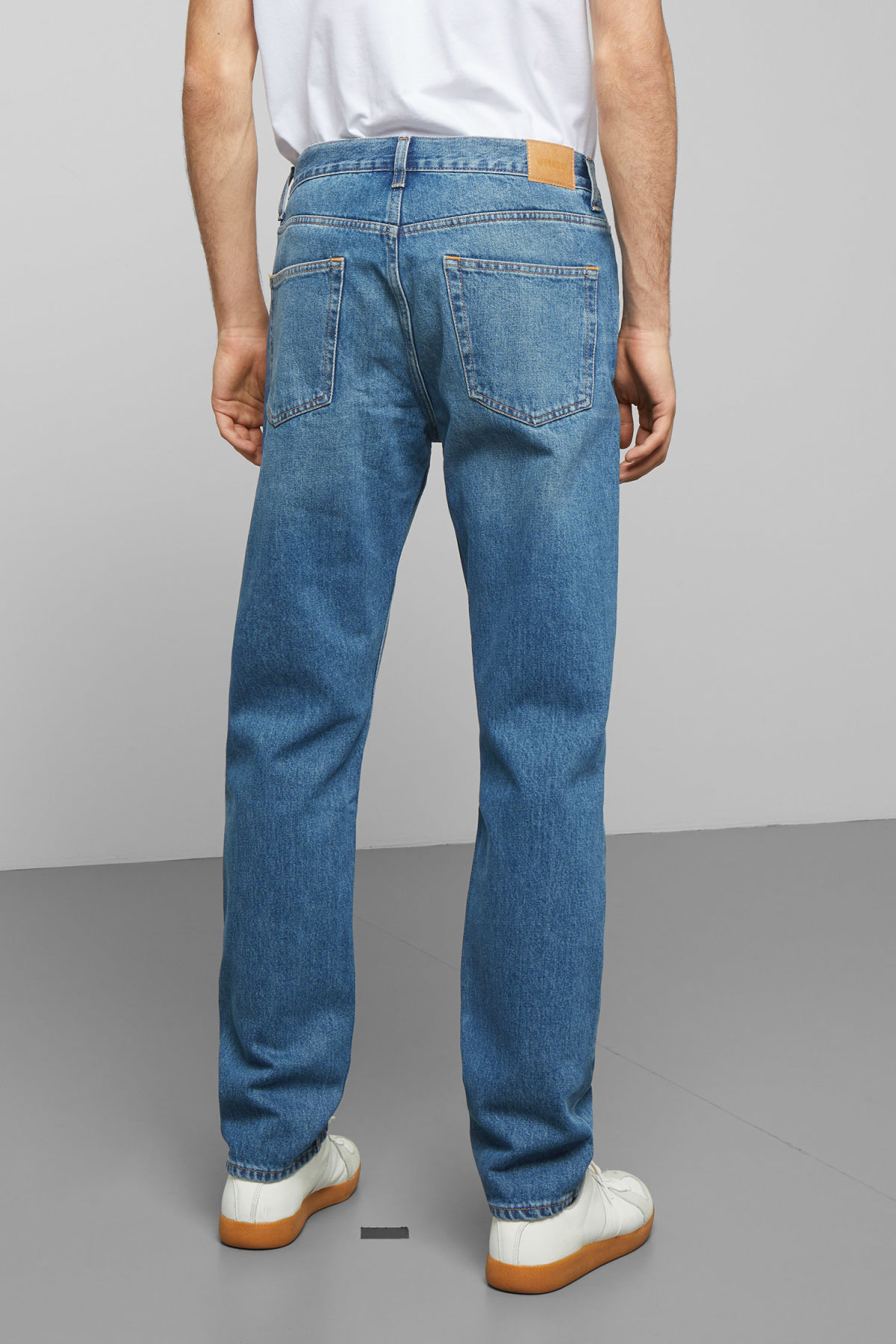 Model side image of Weekday pine marfa blue jeans in blue