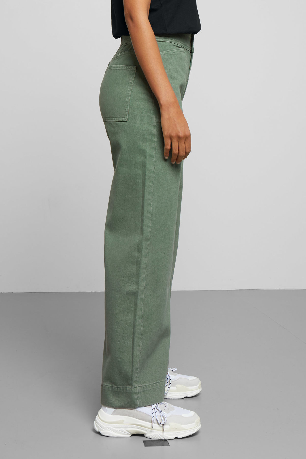 Model side image of Weekday workwear green jeans in green