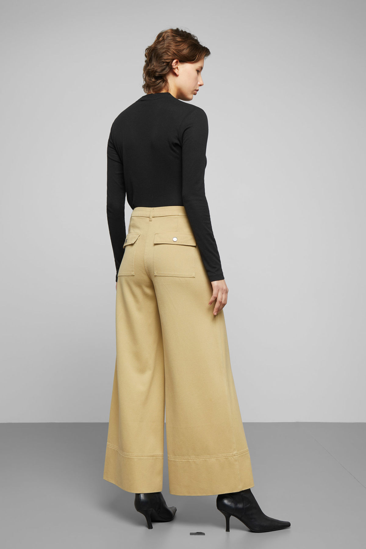 Model back image of Weekday kim trousers in yellow