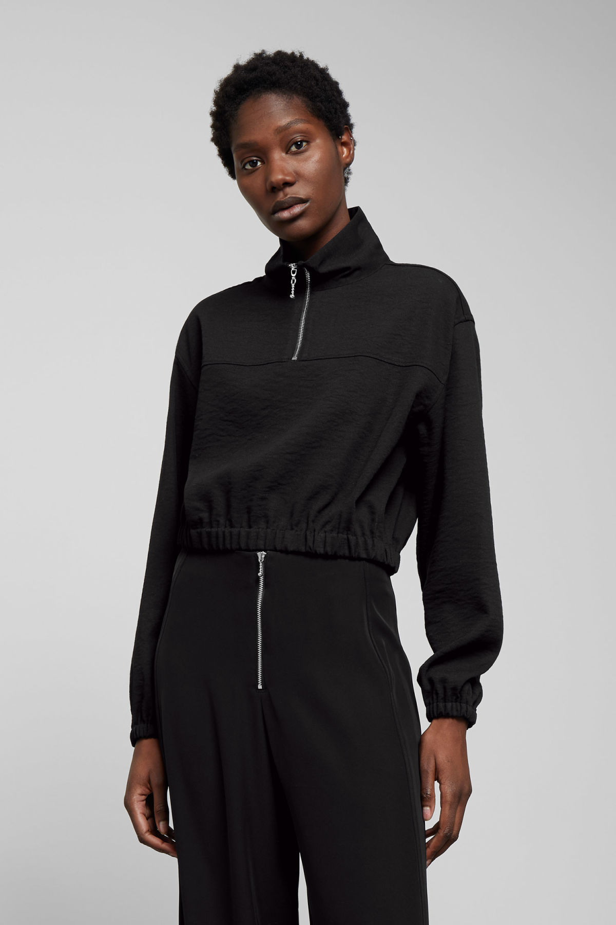 Model front image of Weekday agda zip blouse in black