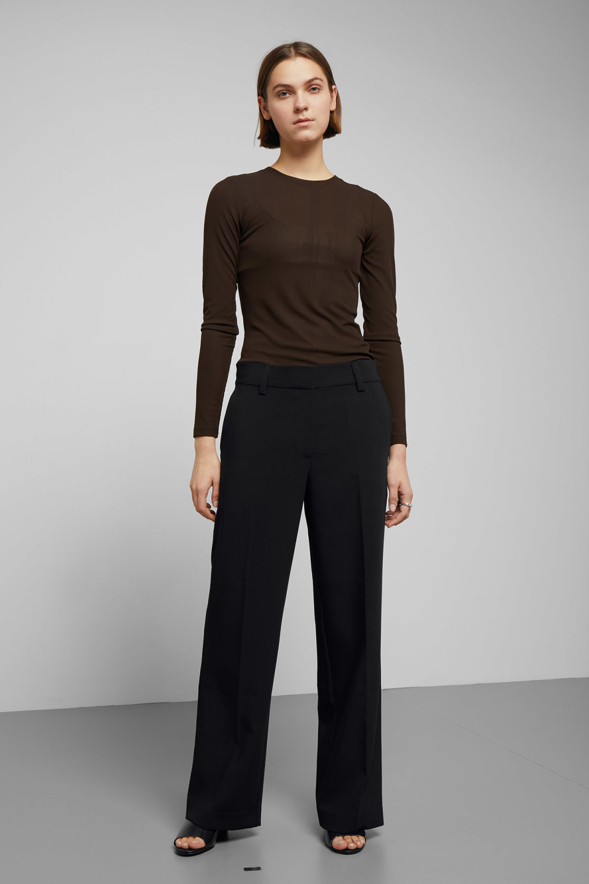 Model front image of Weekday jaana trousers in black
