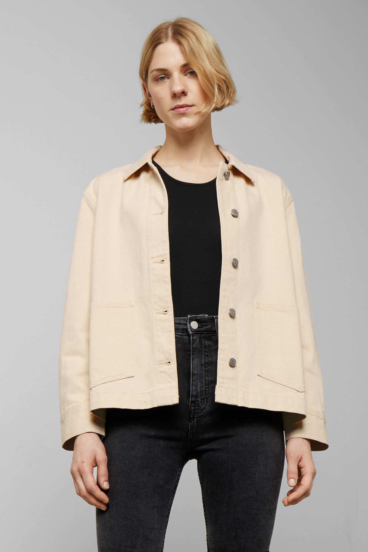 Model front image of Weekday dual ecru denim jacket  in beige