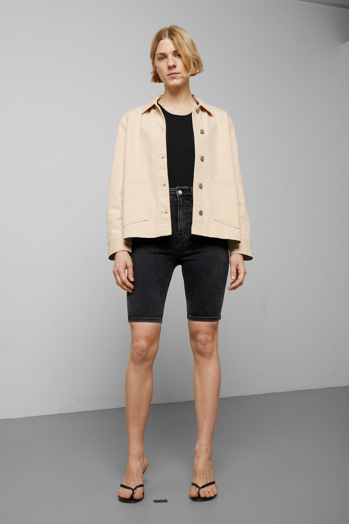 Model side image of Weekday dual ecru denim jacket  in beige