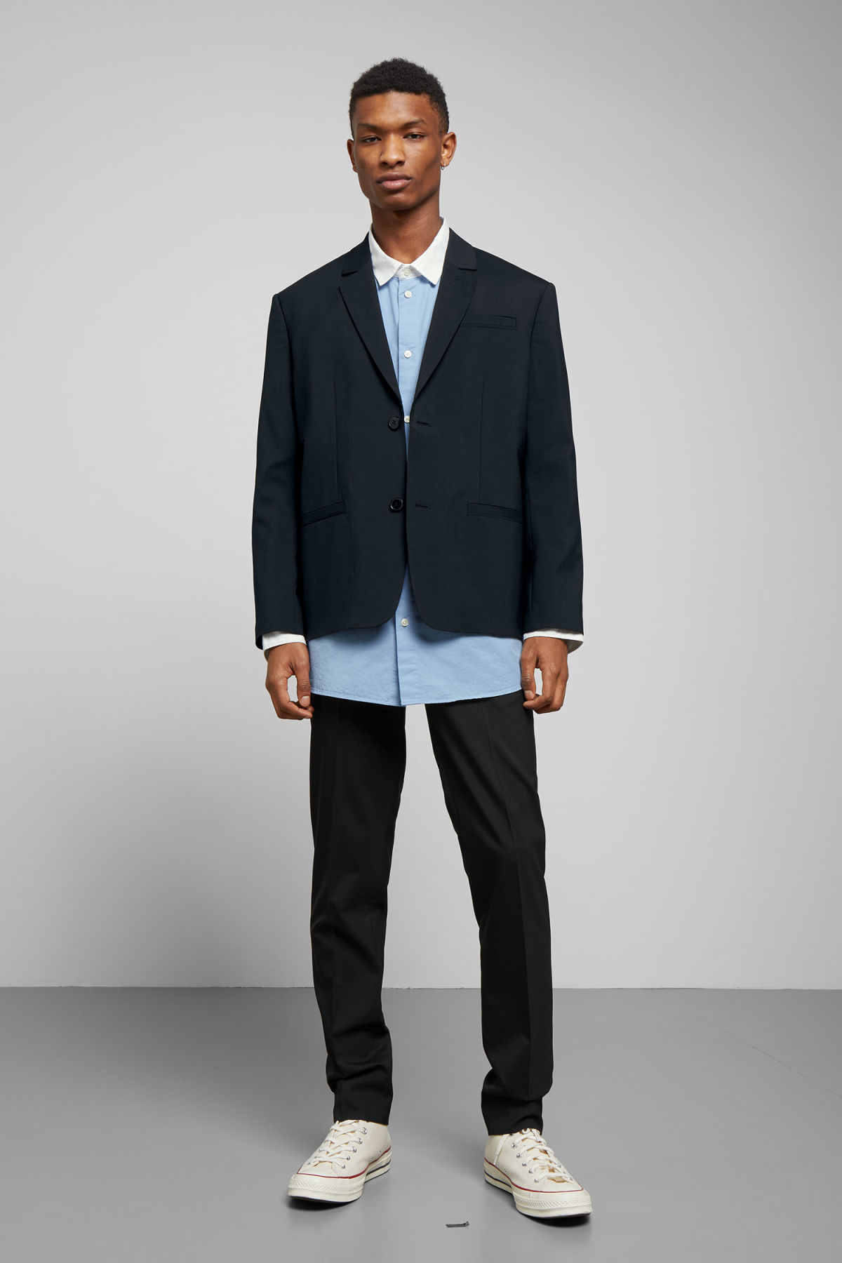 Model side image of Weekday marzio wool blend suit jacket in black