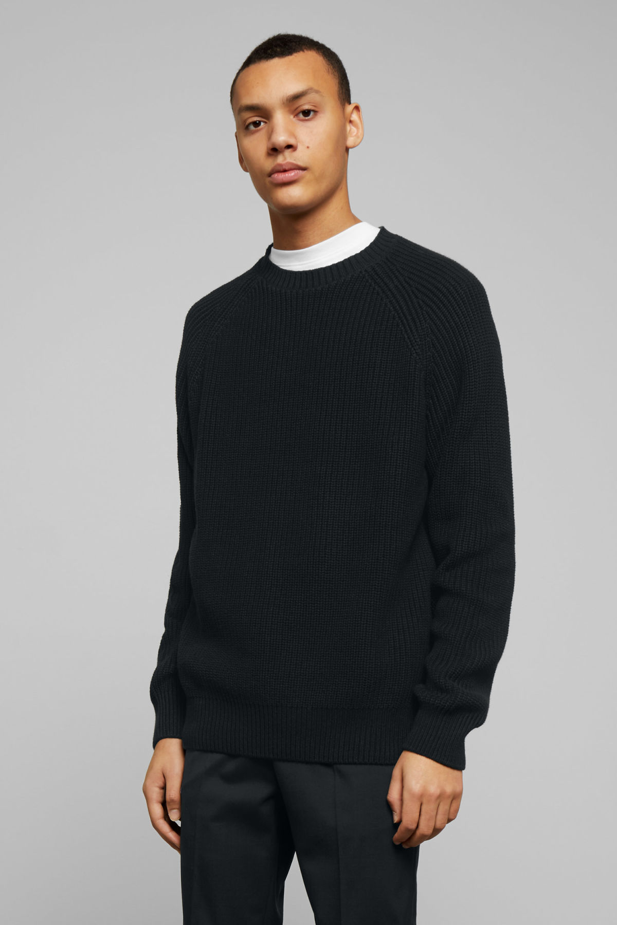 Model front image of Weekday sterling sweater in black