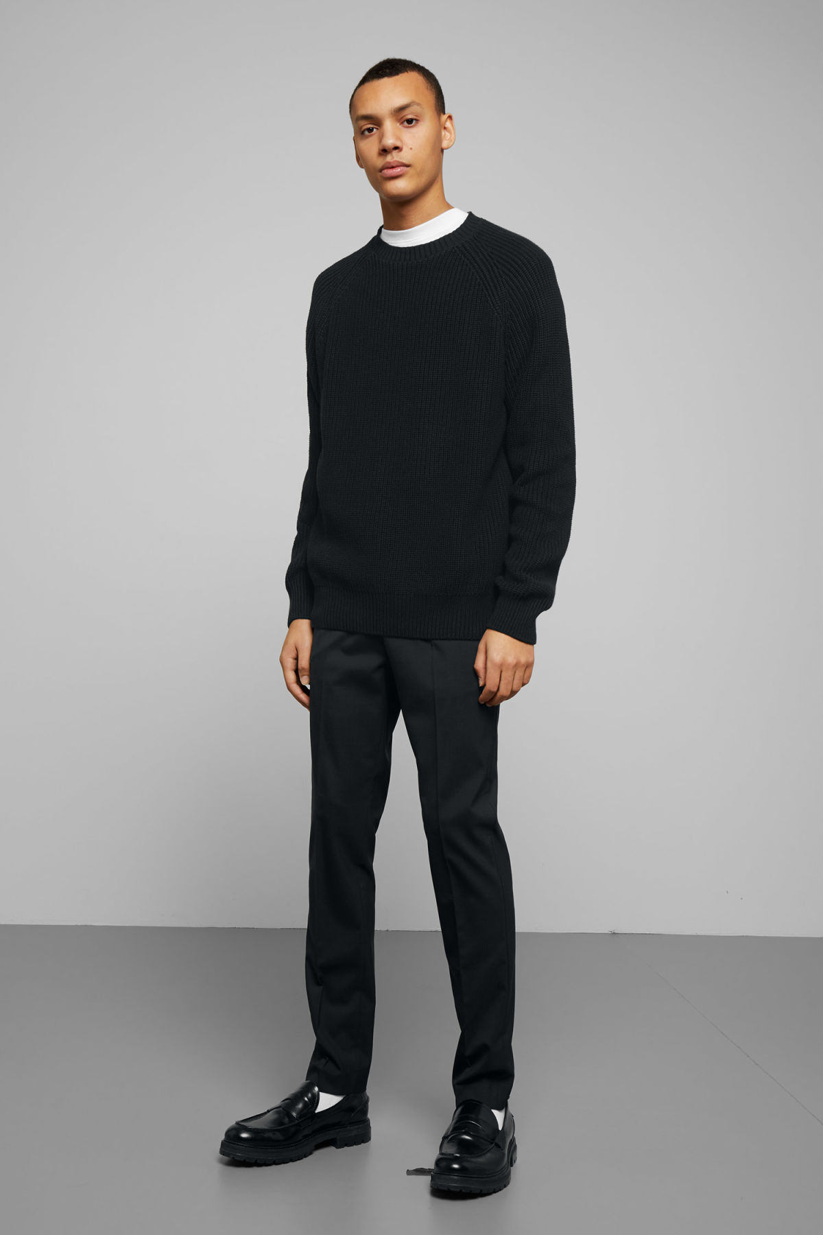 Model side image of Weekday sterling sweater in black