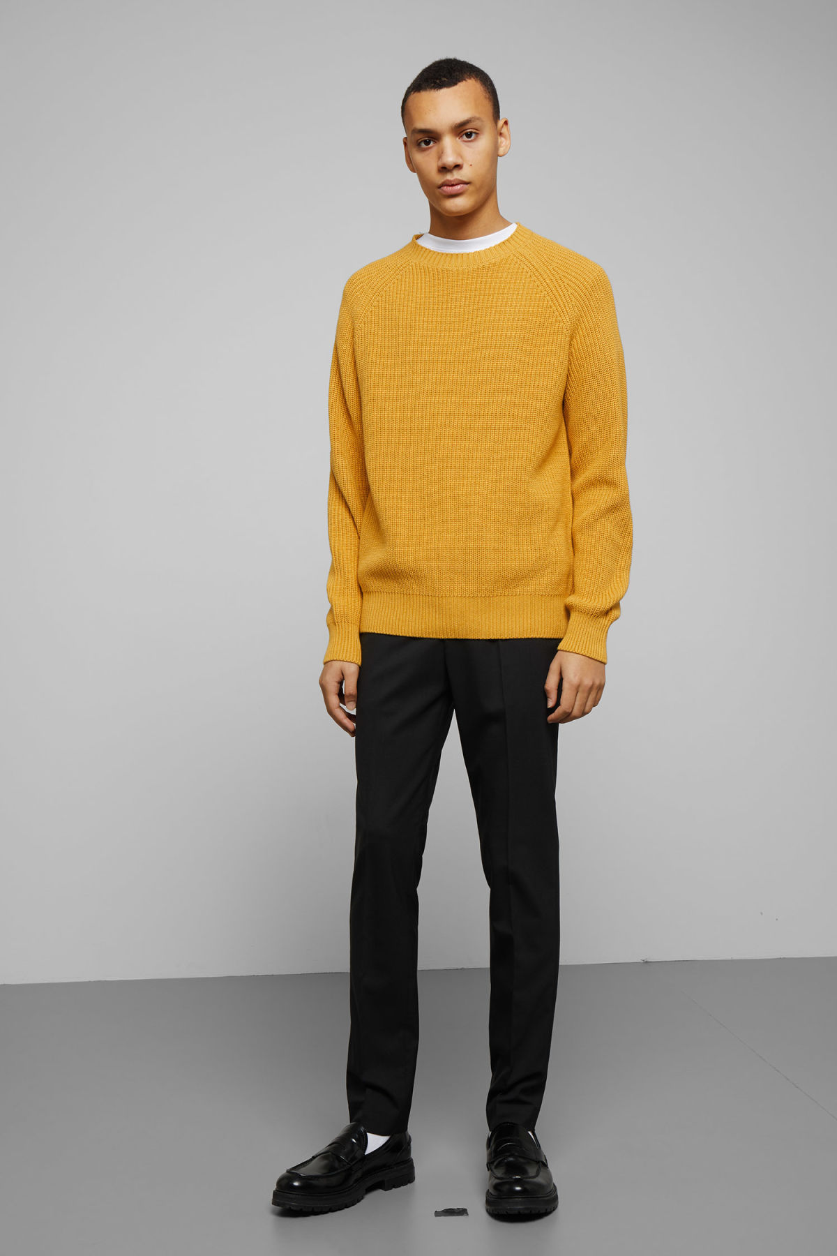 Model side image of Weekday sterling sweater in yellow