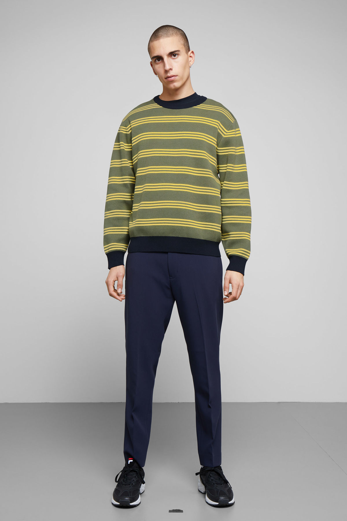 Model side image of Weekday johan striped sweater in green