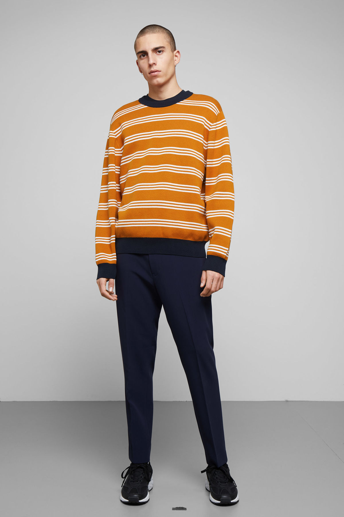 Model side image of Weekday johan striped sweater in yellow